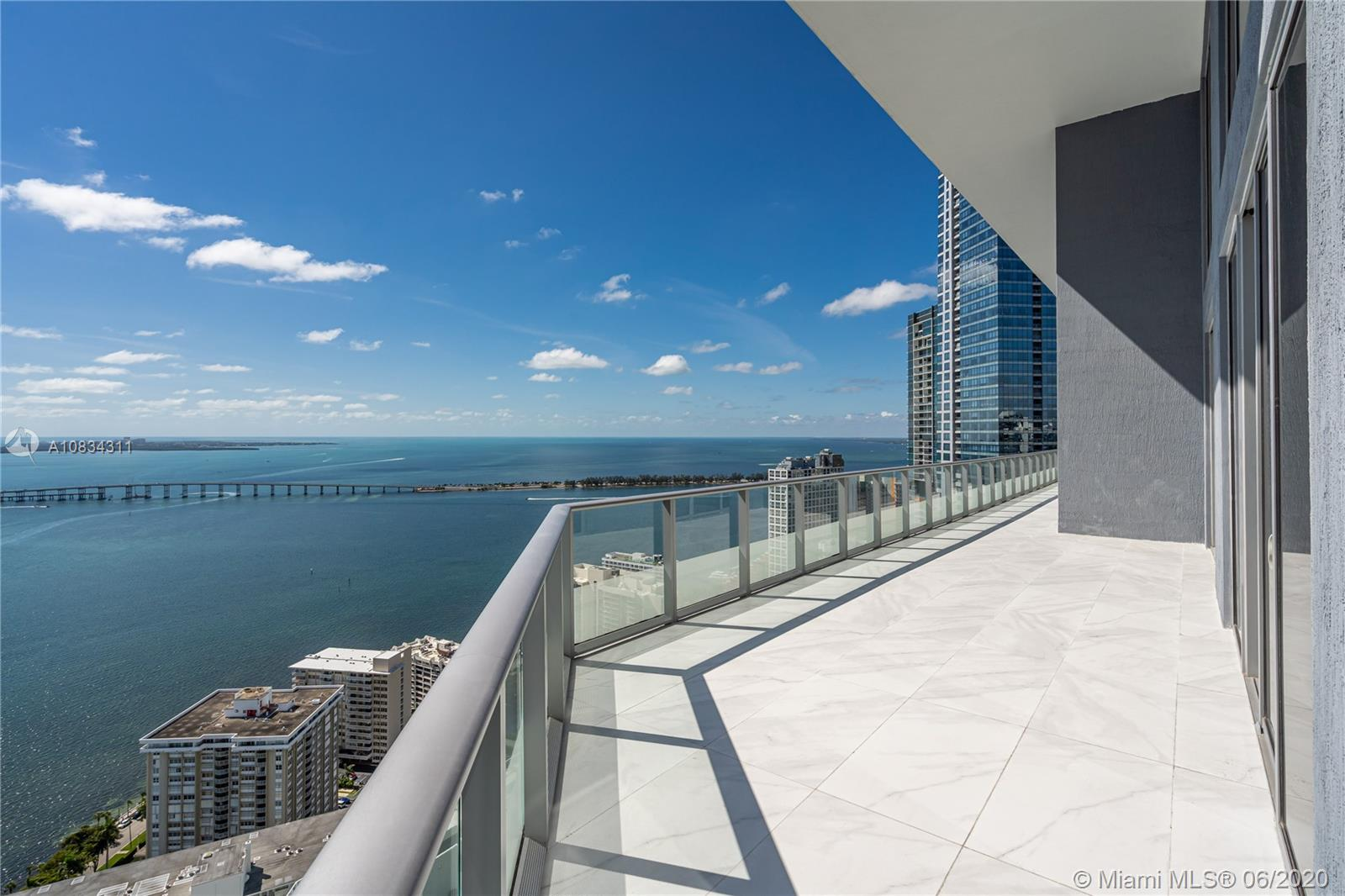 Breathtaking waterviews from this brand new 2 Story Penthouse.  20 feet high ceilings, italian designer open kitchen plus full size Butler's Kitchen. Lovely white 24 x 48 white italian white porcelain.   6 bedrooms 6.5 Bathrooms and includes Maid's Quarters with separate entrance, floor-to-ceiling glass impact resistant windows, movie theater room, family room, office-library, huge walk-in california closets, large balconies and impressive open spaces. 5 parking spaces. Luxury building with top of the line amenities. 24/7 security and concierge, pool, gym, spa, movie theater, social room and more. A must see. Easy to show! Best in Brickell!