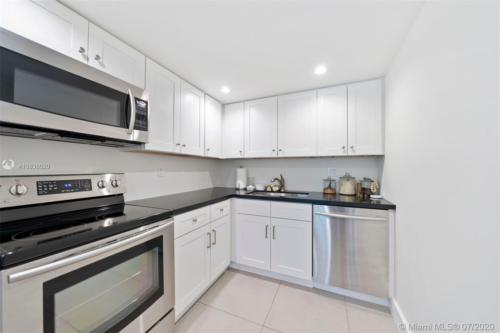 Remodeled, light and bright, perfectly located 1 bedroom/ 1.5 bathroom condo in the City of South Miami. Main level has open living area, brand new kitchen with stainless steel appliances and white cabinetry, half bath and balcony providing lovely treetop views. Fantastic tile flooring. Washer and dryer in unit. New AC. Upstairs you will find a generously sized suite with sitting area, dressing area and renovated bath, two closets., carpet flooring. Gated, assigned parking space. Secure entry to building. Fantastic walkability; less than two blocks to the shops and restaurants of South Miami.