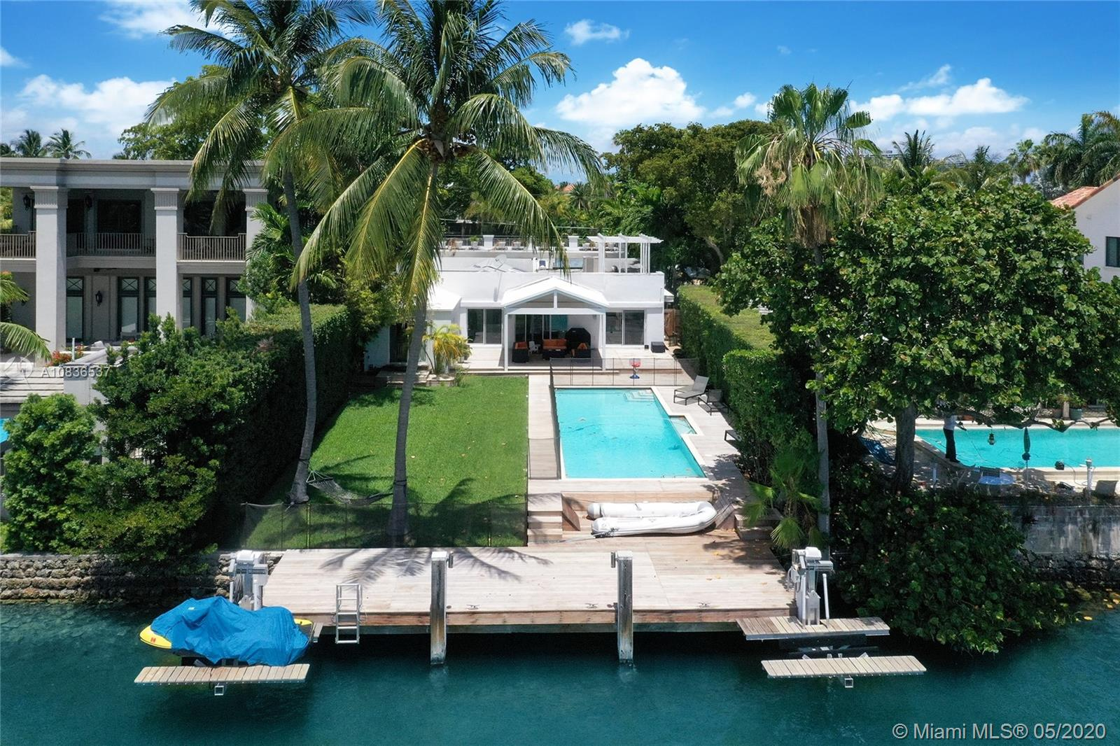The least expensive waterfront property on exclusive gated Hibiscus Island in South Beach, minutes from World famous Ocean Drive, Downtown Miami and Brickell. Make it your home or tear it down and build another luxurious Palace on the Island! One of the last waterfront homes or site available at close to land value. The Island also includes tennis courts for outdoor sports. The private dock for your boat and jet ski lifts overlook the peaceful wide canal. Property has direct access to the Intracoastal Waterways and the Ocean. Great floor plan: a separate wing at entrance leads to 2 bed/2 baths. Den/office enjoys the entire living area. 2 master suites open to the pool deck & overlook the  Palaces of Palm Island across the sparkling blue waters. Enjoy South exposure and Downtown views !