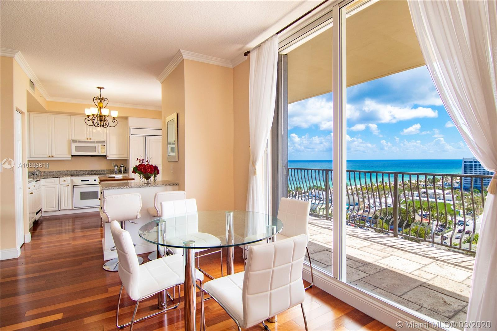 Located steps away from the beach and Las Olas Boulevard,  this stunning 2 + den, 2.5 bath condo inside the iconic Jackson Tower in the heart of the Fort Lauderdale entertainment district is the ultimate combination of what South Florida has to offer. Private elevator brings you to the open concept living area with striking views of the Atlantic Ocean, Intracoastal waterways, and downtown Fort Lauderdale. The unit features pristine Brazillian cherry wood floors, oversized balcony accessible from all rooms, and a spacious master bedroom. It's a must-see to truly appreciate. Resort-style building is pet friendly and provides plenty of amenities for all to enjoy. Priced competitively for a quick sale. Rentable right away for a minimum of 6 months twice a year.