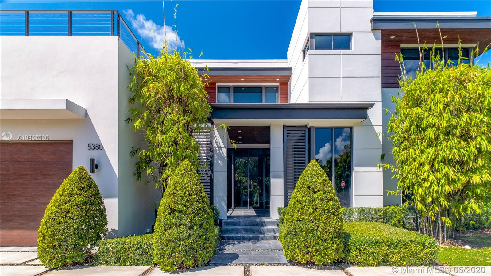"Miami Modern Masterpiece occupies a coveted High Pines corner lot. Built for the Ages in 2015 of reinforced concrete w/impact doors/windows & epay façade, this generously scaled 2-story residence is bright & airy, voluminous & expansive w/10' ceilings & 3'x3' Italian porcelain floors. Flow-thru interiors heighten the sense of contemporary luxury. Crisp whites & elegant grays unify understated steel, wood & glass elements. Impeccable Subzero/Wolfe kitchen; simply grand Master suite. Staged for gracious indoor/outdoor entertaining w/vast covered & open terraces, entry fountain, 2-car garage w/finished floors, plunge pool & mature ""privacy"" landscaping. A sensational turn-key residence located in a close-in, highly sought, walkable enclave w/top-tier schools."
