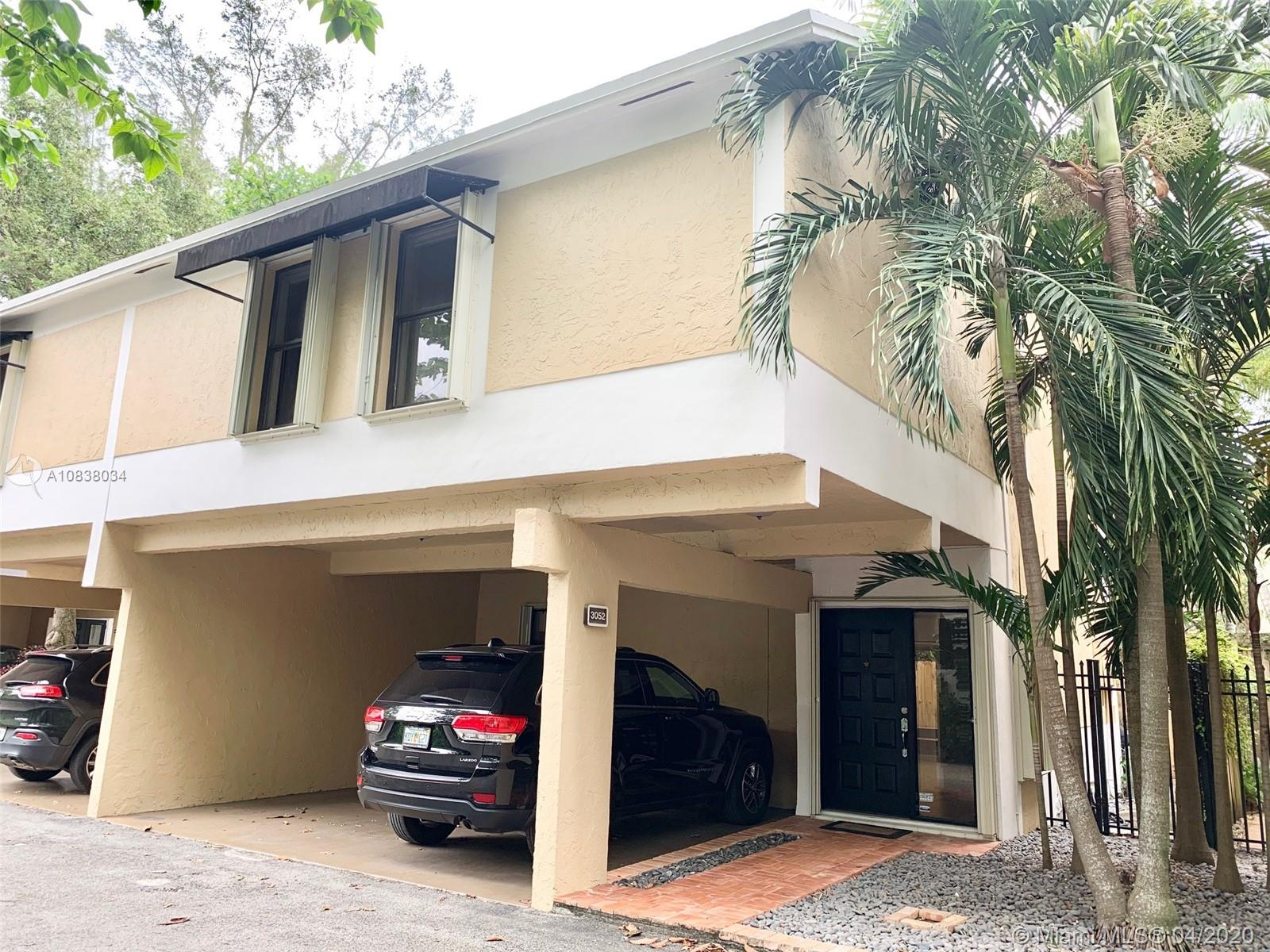 This is Coconut Grove at its most charming! Beautifully updated townhouse located in the heart of Coconut Grove across from Blanche Park. Private, very quiet gated community of ten townhouses in a cul-de-sac. High ceiling with expansive windows brings in light from the beautiful private terrace perfect for entertaining and barbecuing. Living room features 48X48 tile with white bamboo flooring in the bedrooms. Kraus kitchen sink, solid glass backsplash with quartz countertops & JennAir appliances, stone showers with imported contemporary SSWW German fixtures. Window treatments and lighting have also been updated. New roof, skylights & new exterior paint. 2 Assigned and covered parking space next to entrance of townhouse. Easy to show.
