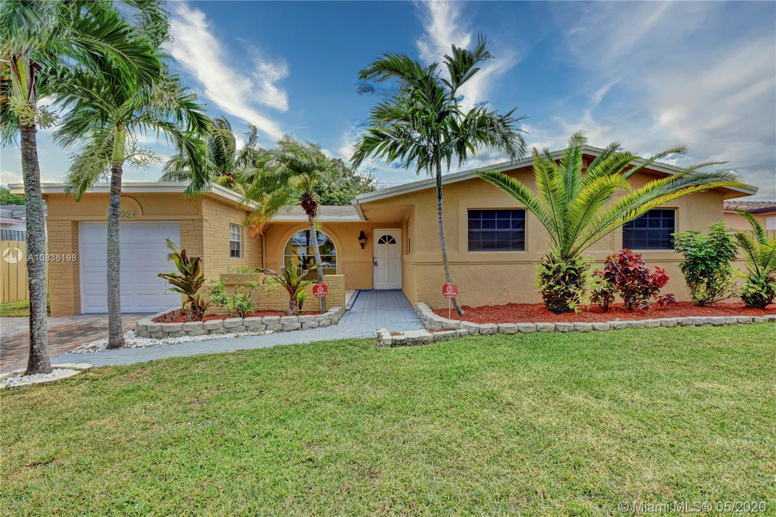 This updated, Spacious Move-in ready, turn key 3 bedroom 2 bathroom Pool Home in Lauderhill is located in a quiet community of Holiday Village. As you walk into this gorgeous turn-key single family home with a split-floor plan, you'll see beautiful stone accent wall to your left, new Flooring, gorgeous Kitchen with updated cabinets and Granite counter tops, New Stainless Steel Appliances & New washer & dryer, French doors, private contemporary style bar, newly painted interior & exterior, with lots of natural light. Both bathrooms have new vanities and New A/C. Home has Impact Garage Door. Huge landscaped backyard features include: Coconut Tree, Tall Palm Trees that provide shade around the pool + fenced yard. No HOA!! No Pet Restrictions!