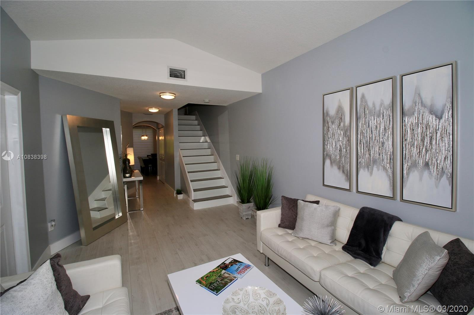 Immaculate, exquisitely designed 2-story townhome with a private patio that invites comfort, and exudes modern elegance. 1bed/1 full bath downstairs and 2 master suites upstairs, generous living space and stylish finishes, you'll enjoy a perfect setting for relaxing and entertaining. Beautiful waterproof modern wood floors and plenty of natural night flow throughout the home's open & airy layout. Modern kitchen cabinets, white quartz waterfall counter-top, new bathrooms, master bath with SS shower bar, water proof wood floors throughout, all led light fixtures, horizontal flat sheer shades, top of the line SS appliances. Impressive, secluded and quiet backyard. AC is only 5 years old,