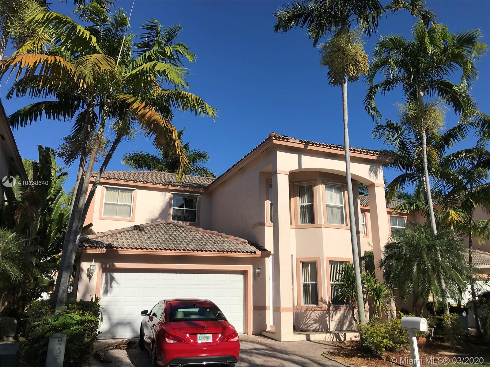 "VACANT. Beautiful 3/2+ loft with wet bar. 3rd bedroom used as closet, easily made back to room. 2005 built home, high ceilings throughout, 20"" tile floors downstairs, new wood laminate in bedrooms. Custom wall fireplaces. Kitchen has 42"" cabinets, stainless steel appliances, alkaline H2O system & breakfast area overlooking family room. Large master with huge walk in closets. Master bath has dual sinks, jetted tub & separate shower. PVC fenced yard with high end artificial grass for easy maintenance. Storage shed. 2 car garage. Smart home panels, cameras & surround sound with soundport to phone. Hurricane shutters throughout. Gated community with only 19 homes & no strict rules. 1.5 Miles to the beach & Hollywood Boardwalk. Close to Airports, cafes, shopping, casinos, parks & nightlife."