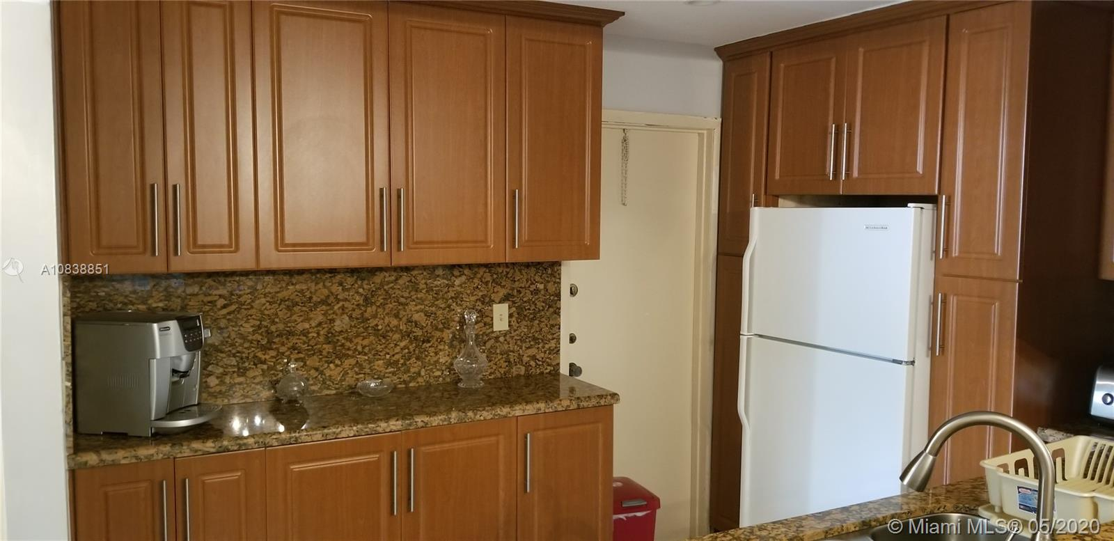 Tastefully remodelled  2/2  corner unit condo in the Emerald building in Oakland Estates. The kitchen  upgrades featuring wood cabinet and granite counter tops !!!. Very spacious unit with tile throughout and huge tiled balcony !! Community offers many amenities including a heated pool, fitness room, card rooms, shuffleboard, bocce courts, and tennis courts!!