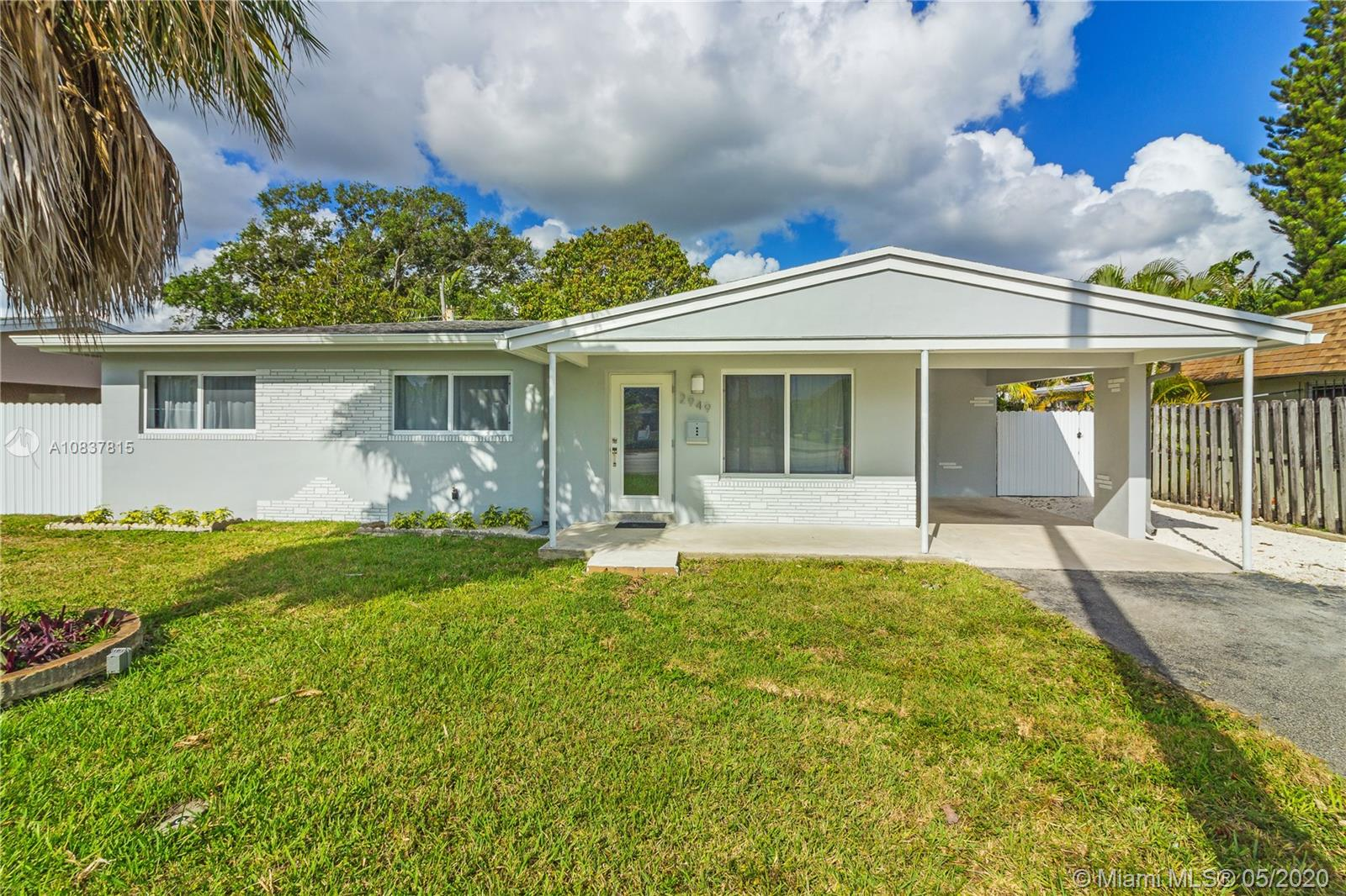 Move-in-Ready!! This lovely home is fully remodeled with great, modern finishes. No details have been spared. Home features 3 bedrooms 2 baths 1315 sf (indoor laundry room added). The kitchen is open with Quartz countertops and stainless steel appliances.  All window are impact, new AC, new tankless water heater, new washer and dryer. Interior and exterior has been newly painted. Original terrazzo floor restored and kept for its beauty and character. NO HOA!! Big backyard with room for pool.  Approval letter required with all offers or proof of funds.