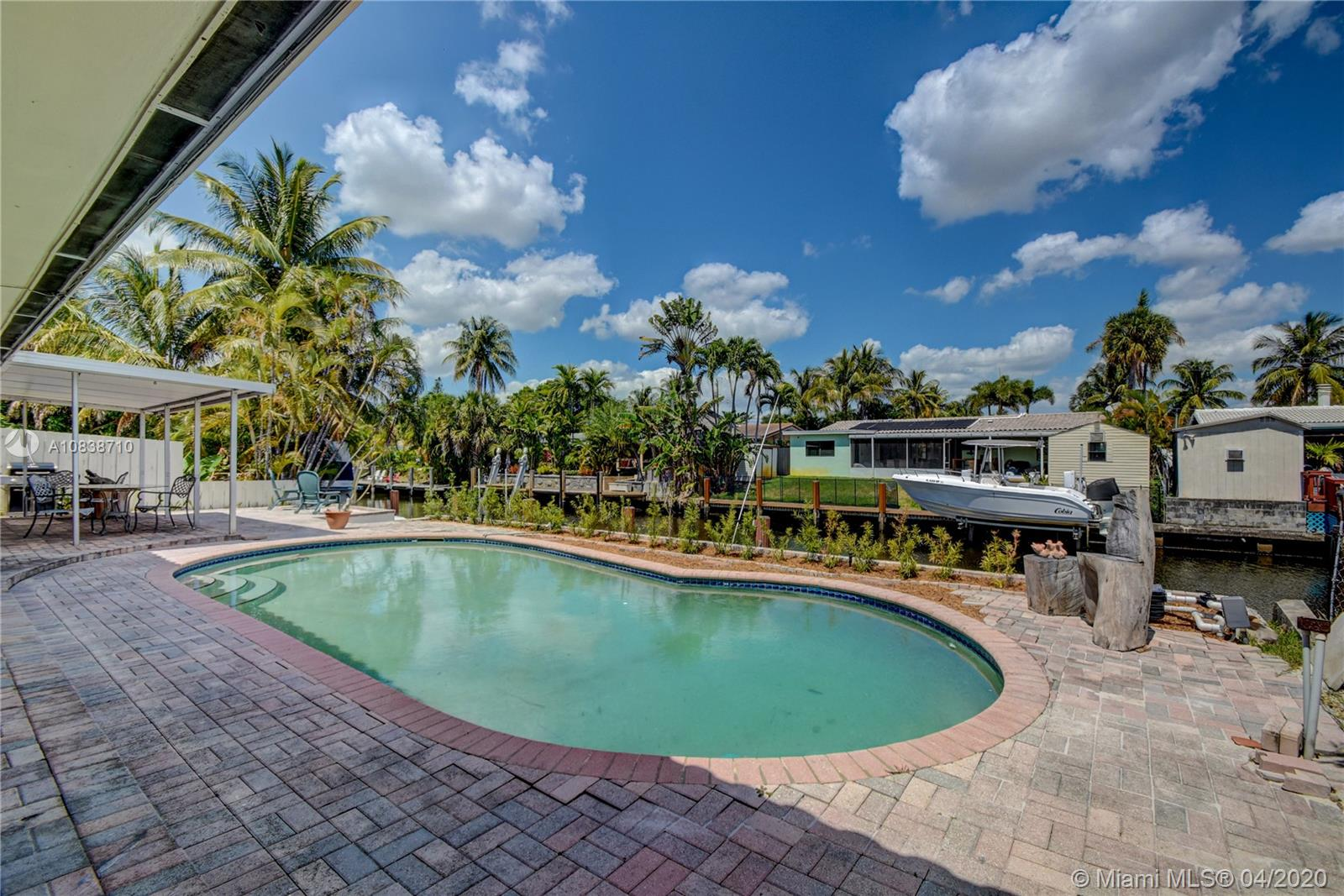 65 feet of waterfront with NO FIXED BRIDGES, 3 bedroom, 2 bathroom, with updated pool and oversized 2 Car Garage (30x24). Location can not be beat~ just off the North Fork of the New River and close to downtown and I-95!  Terrazzo flooring throughout except kitchen.  Lot is 115 x 65.  Easy boat ride to the ocean for boating & fishing enthusiast. NO HOA and NOT in a flood zone.  Showing by appointment with notice.