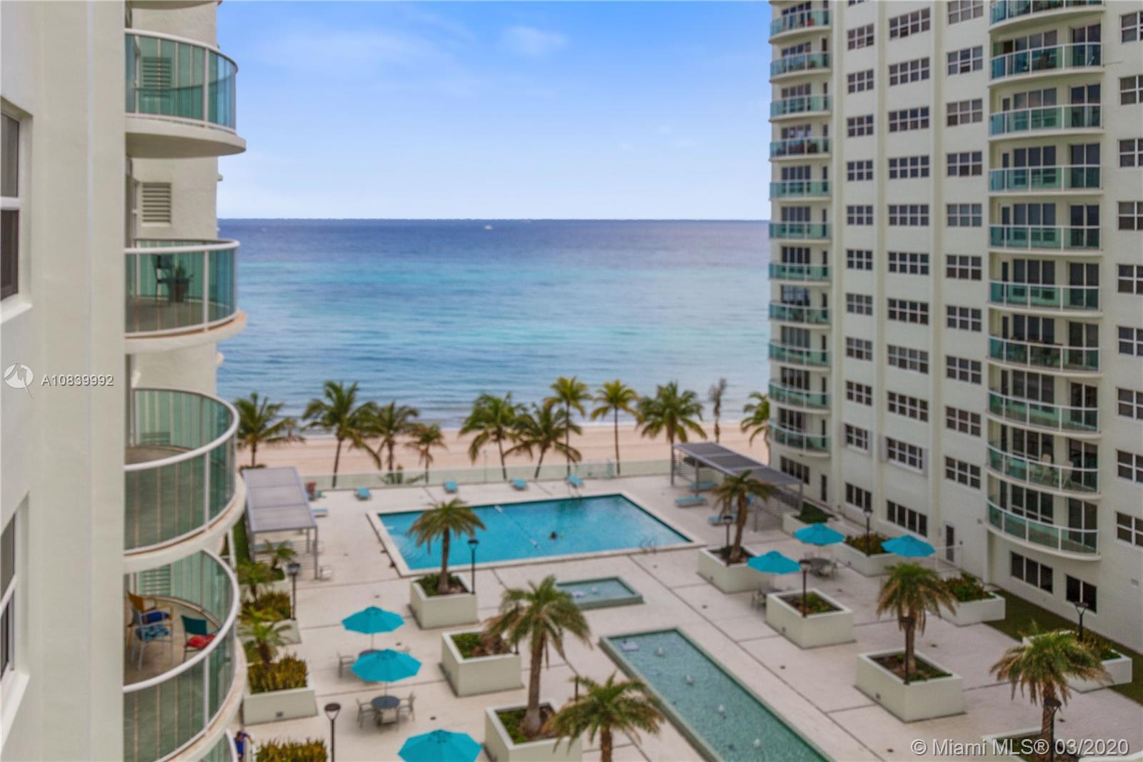 Relax & enjoy oceanfront living in this bright & spacious 2/2 condo located steps from the beach. This corner unit offers South & Eastern views. Hurricane windows and doors throughout. Large master bedroom with walk-in closet, full vanity & large bathroom. Washer & dryer in unit. The building offers resort-style amenities including a brand-new pool, tennis courts, fitness centers, conference rooms, clubrooms, card rooms, billiard rooms & more. Covered underground parking with 24/7 security & reception. Internet, cable, and water included. Walking distance to great shops & restaurants.