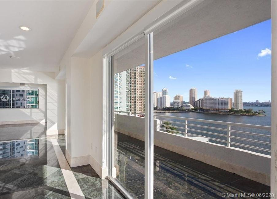 Remarkable Penthouse in the ideal Brickell waterfront location. Unobstructed 360 degree views of Biscayne Bay, Atlantic Ocean and Miami Skyline from this full floor PH residence with 4,110 sqft of living area and 1,350 sqft of wrap around balcony. Featuring 5 bedrooms + Den and 4.5 baths, marble floors, wet bar, and expansive terrace for entertaining. Accessible only through a secured access elevator, key only. Enjoy amenities such as fitness room, pool, barbecue and doorman. Every convenience nearby. Walk to Mary Brickell Village and/or Brickell City Centre. Short drive to Coconut Grove, Key Biscayne and major highways. Commodore Bay is a small, boutique 35 resident building. Enjoy secluded privacy. Close walking proximity to every convenience and entertainment spot. A Must See Today.