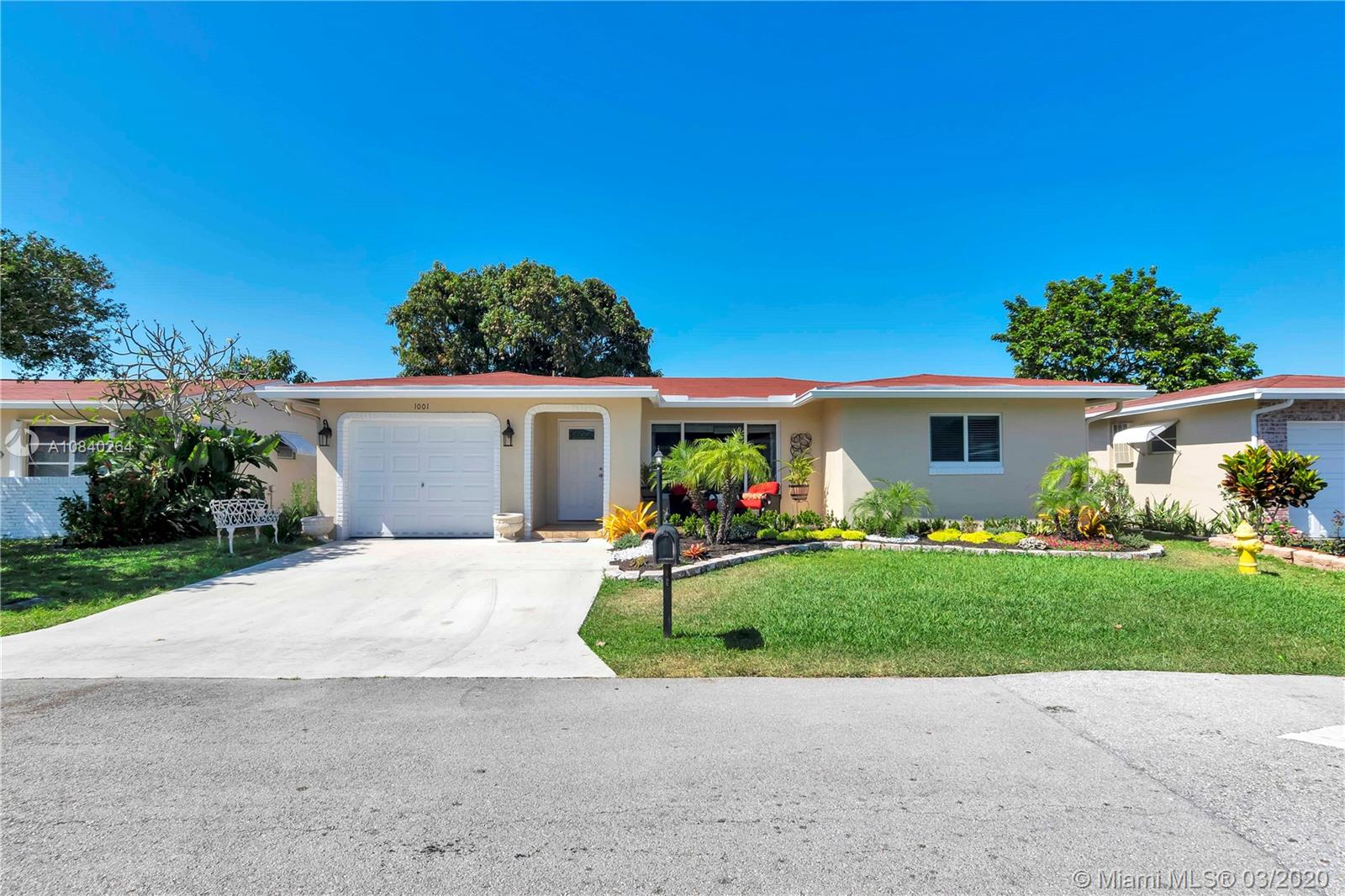 Beautifully upgraded 2 Bed 2 Bath plus bonus space!! Completely remodeled, all impact windows and doors including  garage door, porcelain floors in all living areas, carpet in bedrooms. Plenty of natural lighting. Kitchen, bathrooms, roof and air condition was replaced less than 8 years ago. Low HOA fees which include cable, lawn maintenance and exterior painting every 5 years. This home shows excellent, this is truly a house for someone that just wants to move in and not worry about doing any remodeling. Best in the area, buyer will love it. Come and make this beauty your home sweet home.