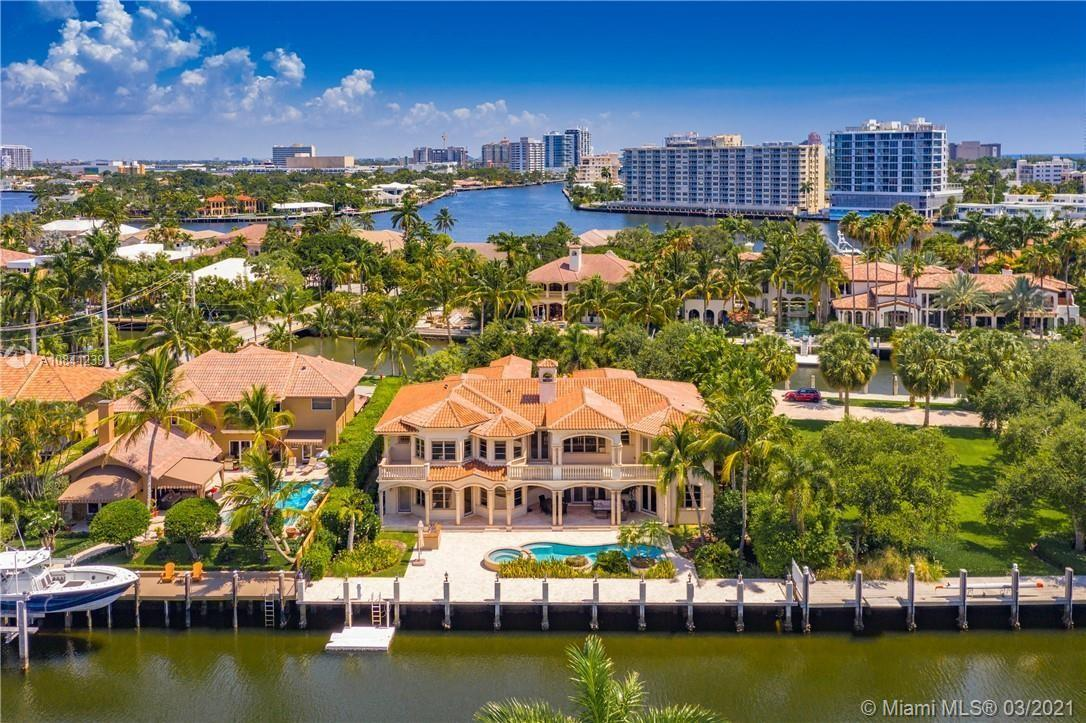 Exceptional Seven Isles estate on a PRIVATE GATED STREET w/a total of 203' of deep water frontage on 2 canals &dockage for multiple yachts. Just 1 house from the Intracoastal point! Features include water views from every bedroom, curved marble & wrought iron staircase, great room w/20' ceilings & magnificent 2-story stone fireplace,master suite w/dual baths, morning bar & sitting room. Theater, gym, elevator. Lutron lighting/smart home system.Perfect for year-round outdoor entertaining w/tumbled marble patio, vast covered area, outdoor summer kitchen & heated pool. Guardhouse at the Seven Isles entrance w/high res camera which records license plates of each vehicle entering & leaving. Walk to the beach, Las Olas dining & shopping!!