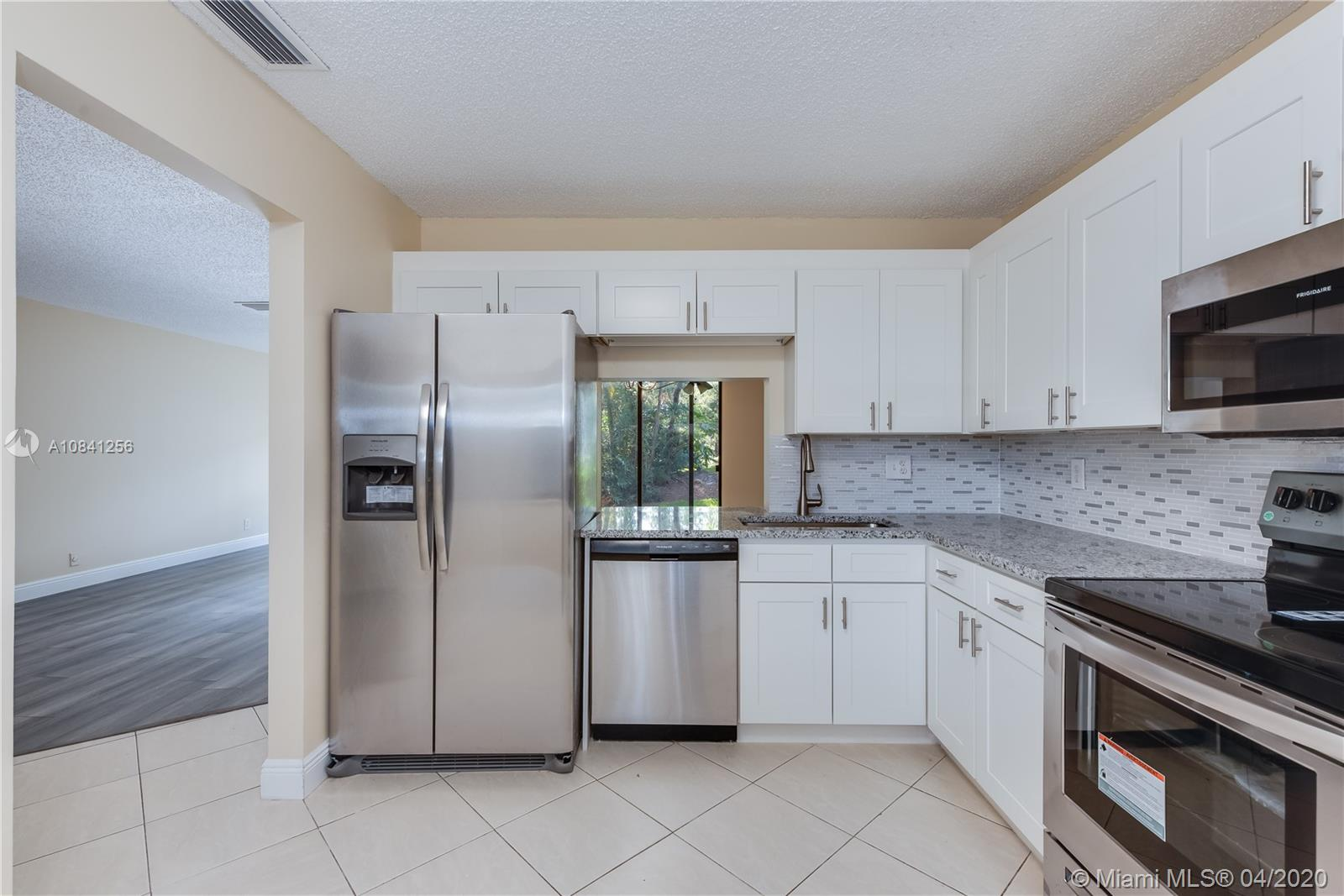 Completely Upgraded & Move-in Ready 2 Bed / 2 Bath Home in Pond Apple Place II in Coconut Creek! Featuring a spacious open layout with New Kitchen with Granite Counter Tops, Modern Wood Cabinets & Brand New SS Appliances. New Washer & Dryer. Large Master Bedroom with a Walk-in Closet, Upgraded Dual Sink Vanity & Tiled Stand-up Shower. Upgraded second bathroom. Enclosed & tiled patio with a ceiling fan & glass sliding doors. The family oriented & well maintained community offers a large pool, children's playground, BBQ area AND MUCH MORE!! SCHEDULE YOUR TOUR NOW!!