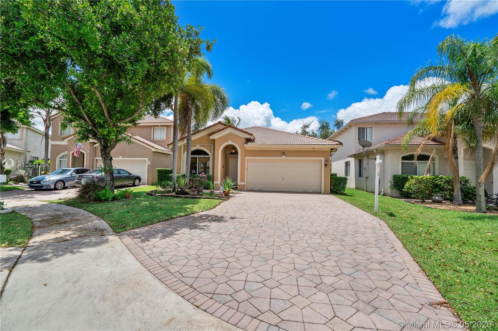 New Listing!Beautiful One Story Home Located on Interior Lakefront Lot + Cul-de-Sac Location perfect for any Family with A+Schools in Coconut Creek. Updated Kitchen with Tumble Marble Back-Splash with Stainless Steel Appliances and Granite Counters and Breakfast Bar which opens to Breakfast Area & Family Room w/Lake Views.Custom Crown Moldings throughout all Living Areas, Large Extended  Screened Patio, Updated Master Bath with Large Walk-in Shower & Updated Vanities for His & Her. Master Bedroom overlooks lake w a large walk-in closet. Updated Guest Bathroom,Accordion shutters,Tiled garage with work bench, pull down attic for extra storage,4 Night Owl Security Cameras.Great location easy access to Boca Raton+all Major Highways, Close to Promenade for shopping+dining. Low Maintenance Fees.