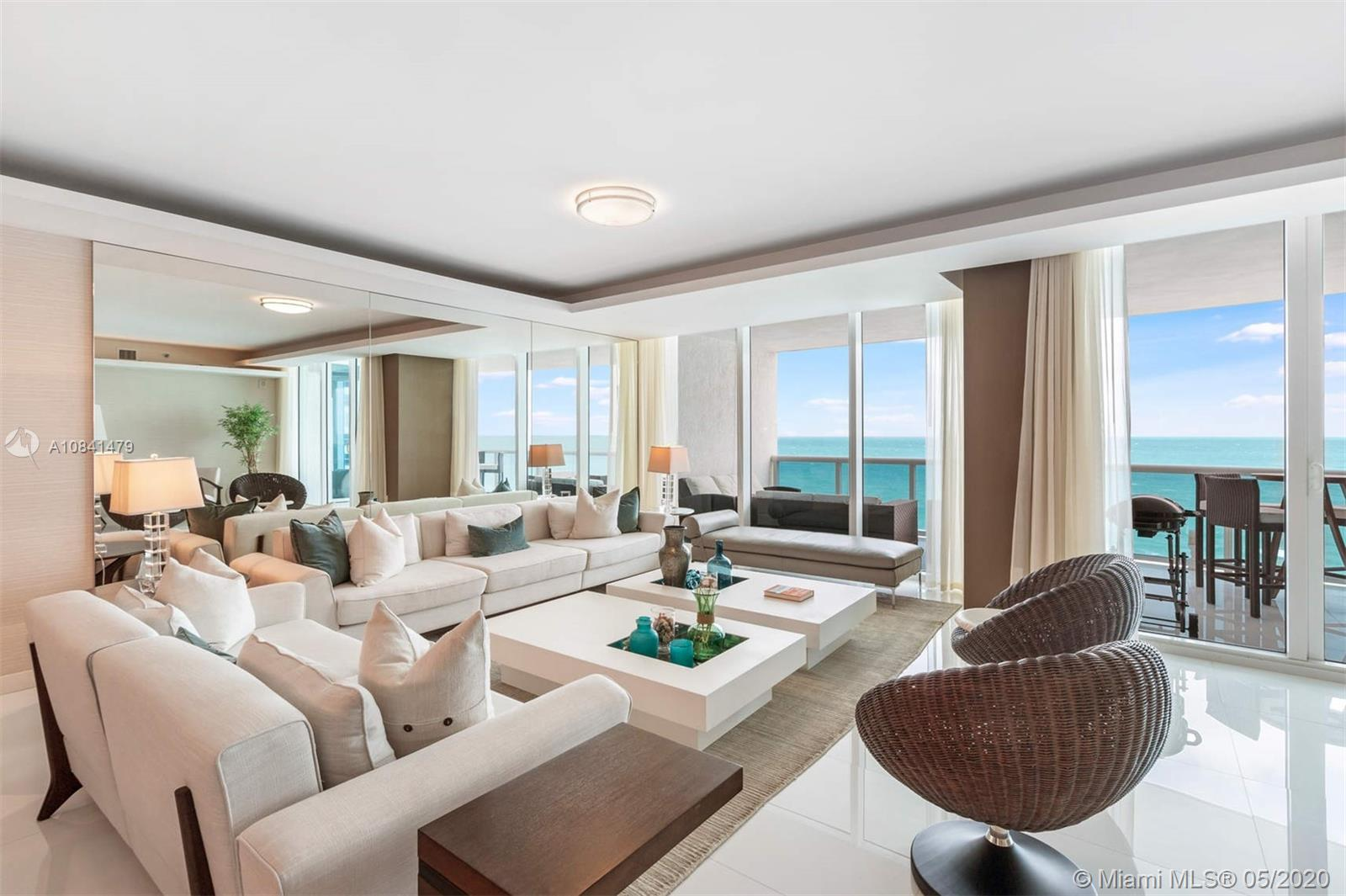 Amazing opportunity to acquire a turnkey residence at prestigious Trump Hollywood, an ocean front condominium that sits on 240 feet of pristine beach in Hollywood, Florida. This unique unit is flow thru with direct views of the ocean and the intracoastal, boasting 3395 sq ft of living area and two expansive balconies. It has been professionally decorated and is ready to move in. The spacious living space makes this unit especially comforting for either your new permanent home or your home away from home. The condominium also offers exceptional amenities such as beach and pool service, restaurant by the pool, 24 hour valet, gym, tennis courts, billiard, just to name a few.