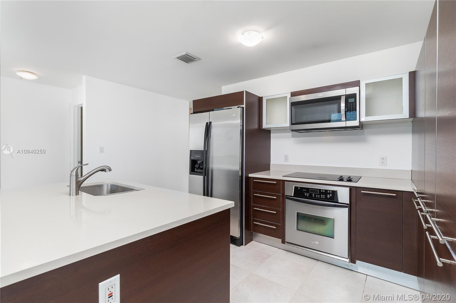 A lovely 2 bed/2 bath corner unit features natural light, gorgeous sunsets and Fantastic Miami skyline views. Enjoy a modern kitchen with island, granite counter tops and stainless steel appliances and wrap around balcony.Building amenities include 2 heated pools, 2 story gym w/ classes available, theater room, business center, 2 lounges/party room, sauna, Jacuzzi, billiard, concierge, 24H security and valet. Minutes from Downtown, the Center for the Arts, Brickell, South Beach and the Design District. Within walking distance of Publix, Parks, American Airlines arena, cafes and restaurants. Call agent for showing instructions. Do not use Show Assist.