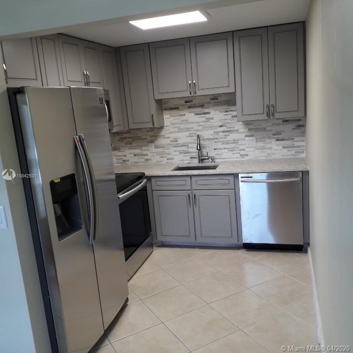 COMPLETELY RENOVATED 2 BEDROOM CONDO IN CENTURY VILLAGE! BRAND NEW KITCHEN & BATHROOMS WITH SOLID WOOD CUSTOM CABINETRY & VANITIES, QUARTZ COUNTERTOPS, STAINLESS STEEL APPLIANCES, NEW DOORS & NEW LAMINATE FLOORING IN BEDROOMS WITH TEXTURED CEILINGS (NO POPCORN!)NEW LED LIGHTING & NEW CEILING FANS & MORE!!!
