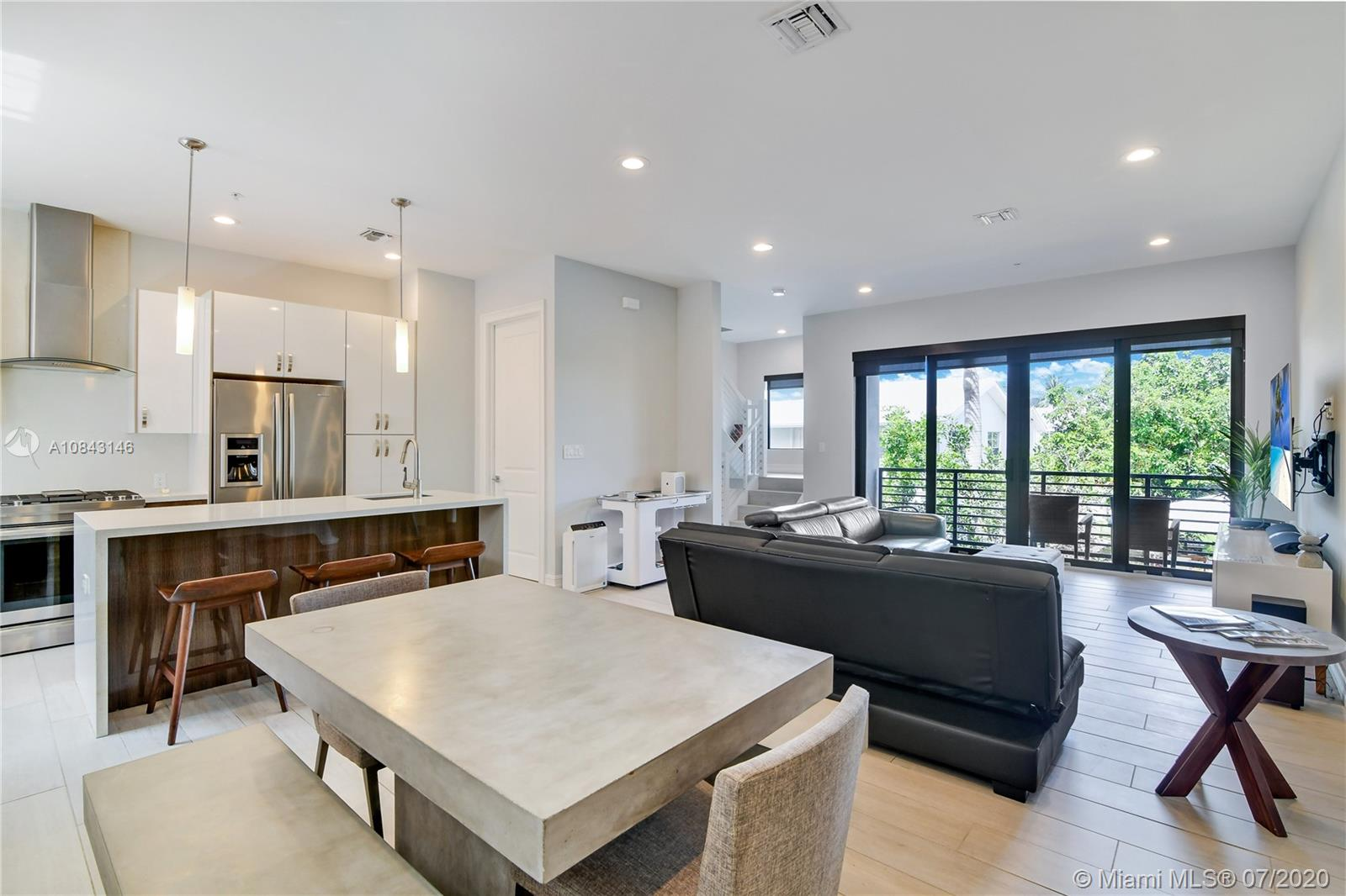 Excellent 3 story furnished smart home ready to move-in! This 2018 constructed townhome features 3.5 bathrooms, 3 bedrooms within 1,916 sq ft. Interior includes custom laminated lacquer cabinetry, high-end Jenn-Aire appliances, quartz tops in kitchen and bathroom, plus tile flooring throughout the home. There is also a double garage, Kevo keyless entry system and private fenced yard with balcony. The listing price includes all furniture and electronics including stainless steel appliances in kitchen (fridge, microwave, oven), washer/dryer, 4 flat-panel TVs with soundbars, 2 queen beds, 2 sofa beds, dining table (for six people), accent furniture and everything a home needs to live in comfort! Smart home has wireless light switches, Wifi controlled garage door and Ecobee smart thermostat.