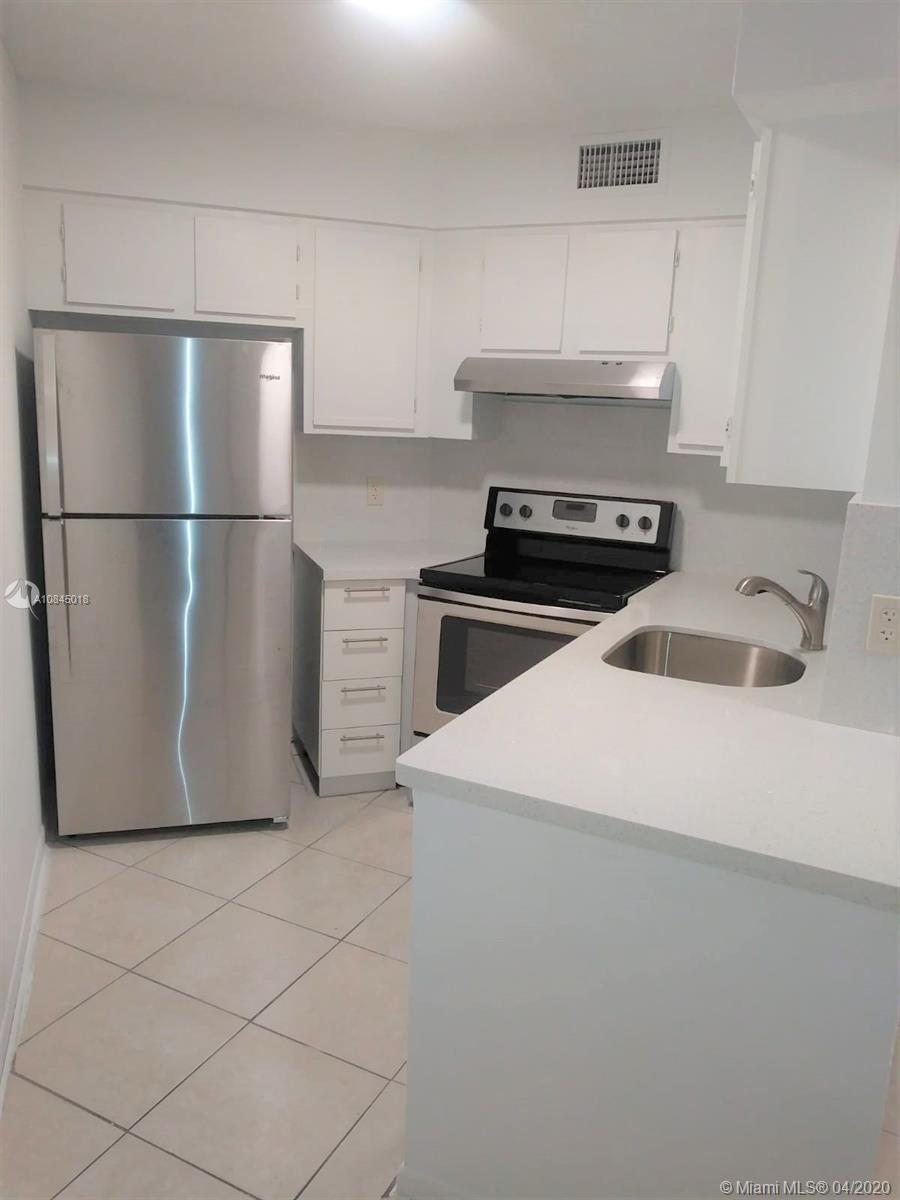 INVESTOR OPPORTUNITY!!! GREAT CAP! COMPLETELY REMODELED!!!, NEW QUARTZ COUNTER IN KITCHEN, NEW STAINLESS STEEL APPLIANCES, NEW A/C UNIT! NEW VANITIES!, NEW LAMINATED WOOD FLOOR! ENJOY THIS TOP FLOOR 2BD/2BA OVERLOOKING THE LAKE FROM A CONVENIENT LOCATION NEAR MAIN ENTRANCE OF COMMUNITY. VAULTED CEILINGS ON THIS LEVEL MAKE SPACE FEEL OPEN AND LARGER. SCREENED PATIO OFFERS ADDITIONAL STORAGE. SEPARATE LIVING AND DINING AREAS. FULL-SIZE WASHER AND DRYER INSIDE UNIT FOR YOUR CONVENIENCE. LIVING AREAS HAVE TILE FLOORS AND BEDROOM HAVE DARK WOOD TONE LAMINATE AND UNIT HAS BEEN FRESHLY PAINTED THROUGHOUT. THIS UNIT IS PERFECT FOR SOMEONE WANTING TO MOVE RIGHT IN AND MAKE IT THEIR OWN. NO RENTAL OR AGE RESTRICTIONS!, RENTED PER $1,400 LEASE WILL EXPIRES 07/31/2021!