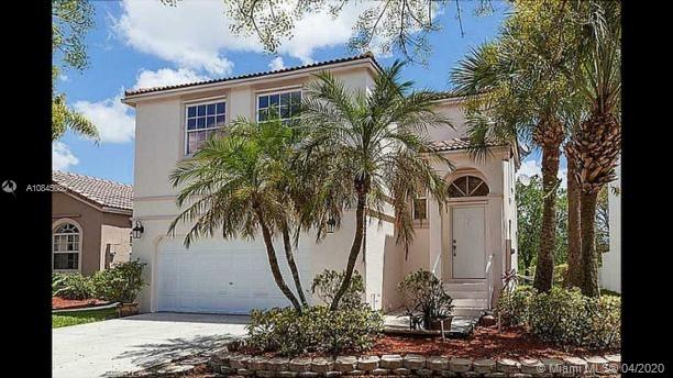 Home in the heart of Pembroke Pines. Amazing 4 bed / 2.5 bath, gated community offering a two story,overlooking the canal. Home in Towngate, this house features, oversize lot, tile on the first floor and laminate floors on the second floor. Kitchen with granite counter top and stainless steel appliances. All 4 bedrooms are upstairs. Located near major roads, shopping center and restaurants. Amenities include community pool and gym.