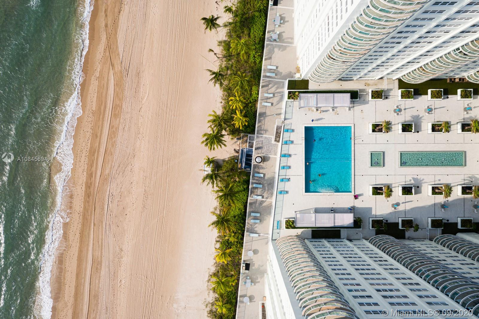 Oceanfront building allows for magnificent sunrise & sunset views from this pristine 16th-floor residence overlooking the ocean & pool on established Galt Ocean Mile Drive in Fort Lauderdale, Florida. Spacious, with over 1,600 sq.ft., offers 2 ensuite bedrooms split plan for privacy. Enjoy great dining room area or eat in the kitchen.Beautifully tiled floors, washer & dryer, upgraded quartz countertops in kitchen, stainless appliances, oversize balcony.Immaculately kept move-in ready. Impact doors & windows. Full-service with manned desk, oceanside pool & cabanas, tennis courts, fitness center, lounge/party room, & on-site manager. Prime location, walk to everything.  No lease 1st yr, pet restrictions. Enjoy the walk-through videos & photos.