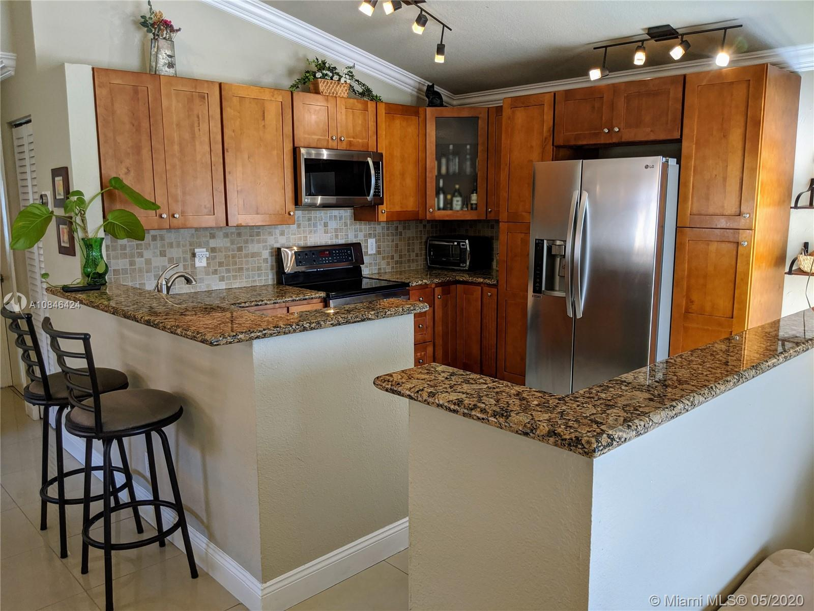 "Enjoy sunsets in beautiful 3/2 home with spectacular wide lake view.  Accordion shutters, gorgeous granite kitchen w/42"" wood cabs, stainless steel appliances.  Updated bath. Open kitchen is fabulous for entertaining with lots of counter space! Garage conversion including A/C, can be restored easily.  Walking distance to Elementary school. Quiet location nestled on the largest lake in Silver Lakes! NO physical showings until 6/7...see video"