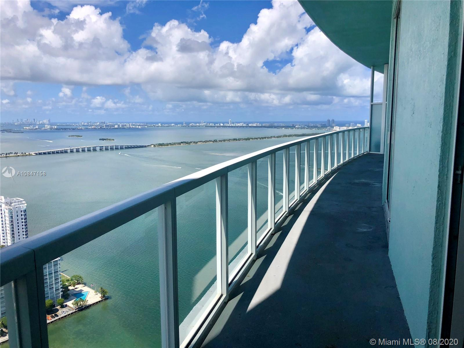 Penthouse Living! Top Floor 3BR + Den/2.5Bth condo with endless views of Biscayne Bay & Miami Beach by day & a stunning city skyline by night. Almost 2000SF plus an additional 270SF terrace. Excellent layout framed by 10 foot+ high ceilings and a deluxe Master Bedroom Suite w/ 3 closets and separate his/her sinks. Additional parking available. High speed Internet, cable & water included.  Quantum on the Bay is a full-service amenity building w/ 24hr security, state-of-the-art Fitness Center, Residents Lounge, Library, Sauna, and 2 Pools, Gourmet market, hair salon and dental practice right on the premises. Enjoy beautiful park grounds across the street and a location that is close proximity to the Design District, the Airport, Midtown & Brickell. Miami is at your fingertips!