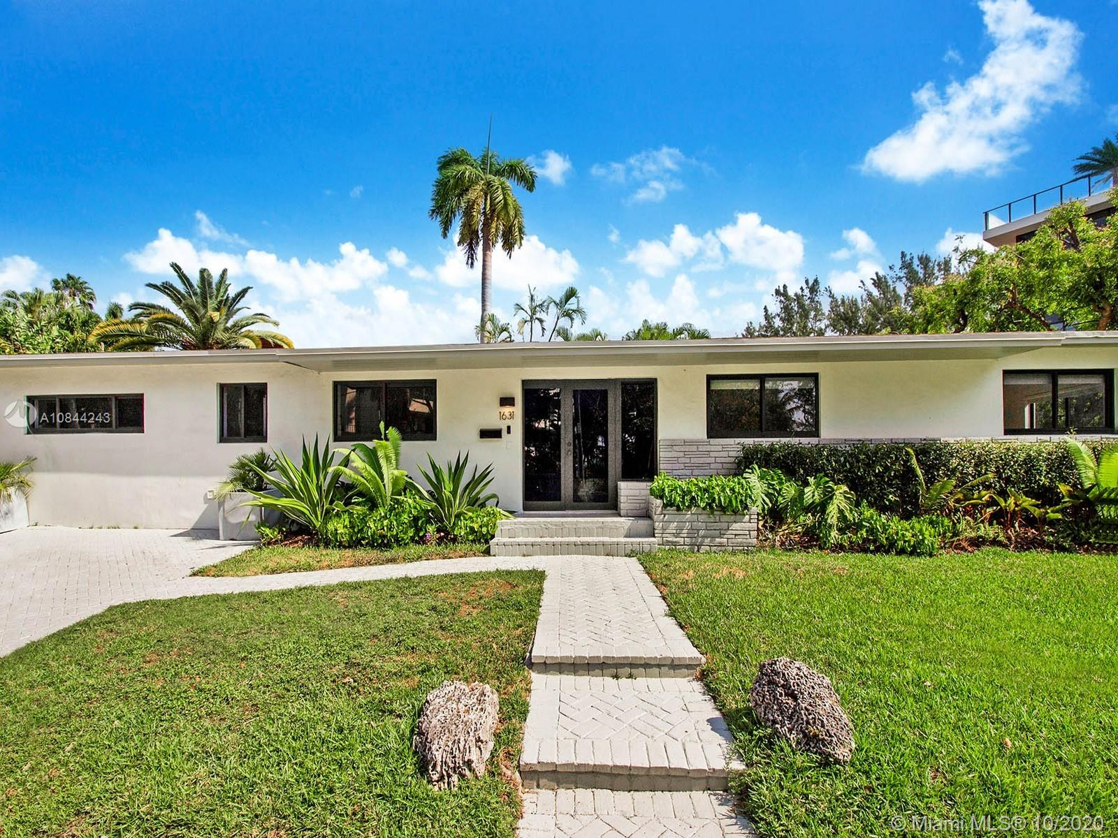 Prime North Coconut Grove location on a quiet street with calming ocean breezes.  This one-story modern residence has been recently renovated including all new impact glass windows and doors. You will love cooking in the freshly designed kitchen with water views of the Bay. Gorgeous terrazzo flooring complements the contemporary vibe and layout. Lushly landscaped with plenty of grass for doggies and kids to play. Playroom may be converted into a 4th bedroom easily. Amazing accessibility to the ocean right across from the home. Walk your paddle board in seconds to your own riparian rights to Biscayne Bay. Stroll over to Kennedy Park, newly designed Cocowalk or jog to downtown. You can't beat this location all day long surrounded by some of the most expensive real estate in Miami!