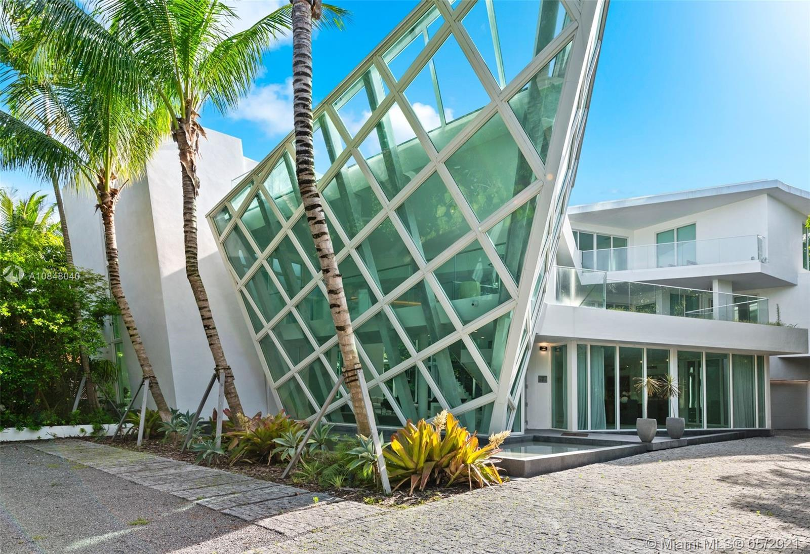 Exquisite Golden Beach Luxury Home, Historically referred to as the Arc. This 9000 sq.ft. Architectural Jewel is a streamline beauty, offering high ceiling contemporary grandeur, with its own private elevator. Alternatively you can climb the state of the art stairway, that leads you to a spectacular roof deck. The unique property also offers lavish walk in closet, Palatial bathrooms and Italian Designer Kitchen. Make an entrance where ever you walk in this 6 bedroom 8 bathroom internationally recognized home. Seller financing available.