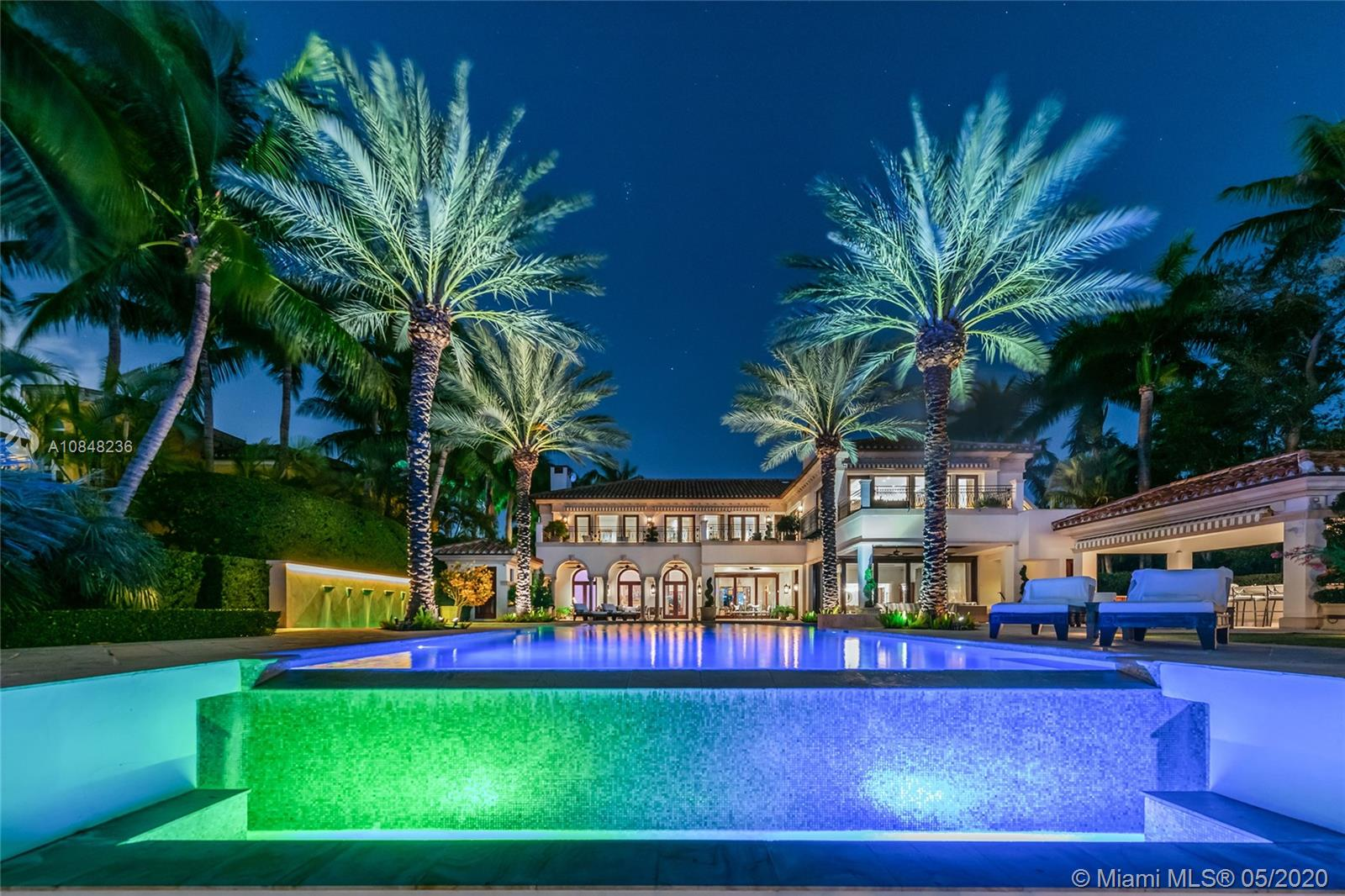 This amazing contemporary 2-Story waterfront estate on exclusive, guard-gated Star Island exemplifies luxury living. The estate sits on a manicured 40,000 SF lot & offers 15,011 SF & 100FT of WF w/direct Biscayne Bay & Miami skyline sunset views. Home features exquisite stone floors, Venetian plaster walls, elevator & living room that opens to the private formal dining room, an industrial-style chef's kitchen, library/den, wine room & great room that opens to the pool area. The 2nd floor principal suite sports a sitting room, office & 2 large terraces w/bay views, plus a bathroom w/expansive onyx/glass steam shower, large walk-in closet & custom spa tub. Outdoor highlights include: pool w/Jacuzzi, cabana bath, covered bar, private 100FT IPE wood dock & Atlantic Ocean access.