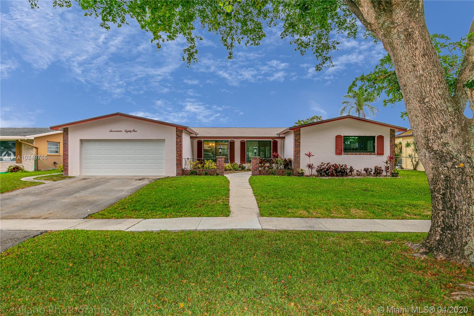 Captivating Ranch Pool Home with breathtaking lake views located in the desirable Pembroke Lakes,  this home features 3 bedrooms and 2 bath, formal dining and living area overlooking the pool and beautiful  lake.  The ample kitchen has a built-in microwave, double oven and gas stove, all appliances are under a transferable home warranty.  ROOF was recently replaced in 2017, air conditioner and water heater from 2010. Home protected with impact windows and sliding doors.   Inviting  family room with a real fire place, perfect to relax or for family gathering.