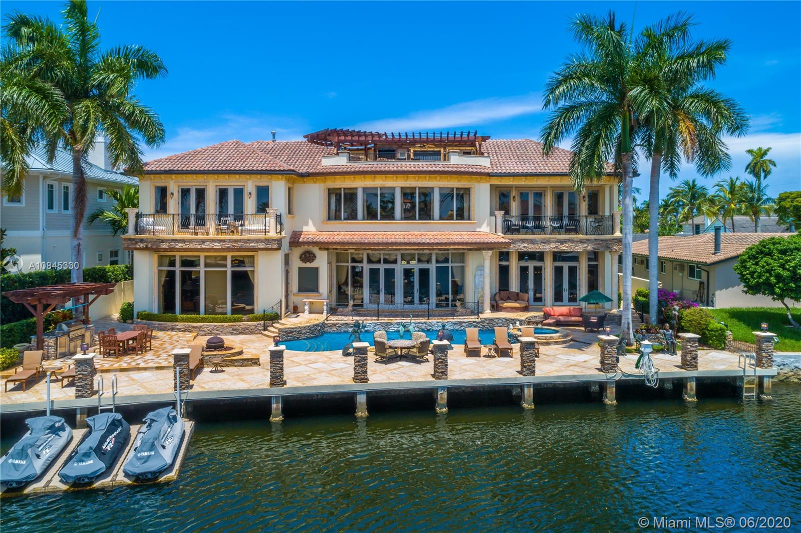 Incredible estate in the heart of Lighthouse Point. Casa Del Toro, is a lavish waterfront home with 5 bedrooms, 7 full bathrooms, and 2 powder rooms. Tucked away on a quiet, deep water canal with ocean access, 108' of water frontage offers water views from nearly every room in the house. A rooftop summer kitchen, three oversized balconies, and an oversized pool deck with a BBQ provide many vignettes to entertain and enjoy the fabulous Florida weather. Home features 9,221 sq ft interior with spacious family room, living room, billiards club with bar, eleven seat home theater, formal dining, sauna, and 3 car garage. House can be shown anytime!