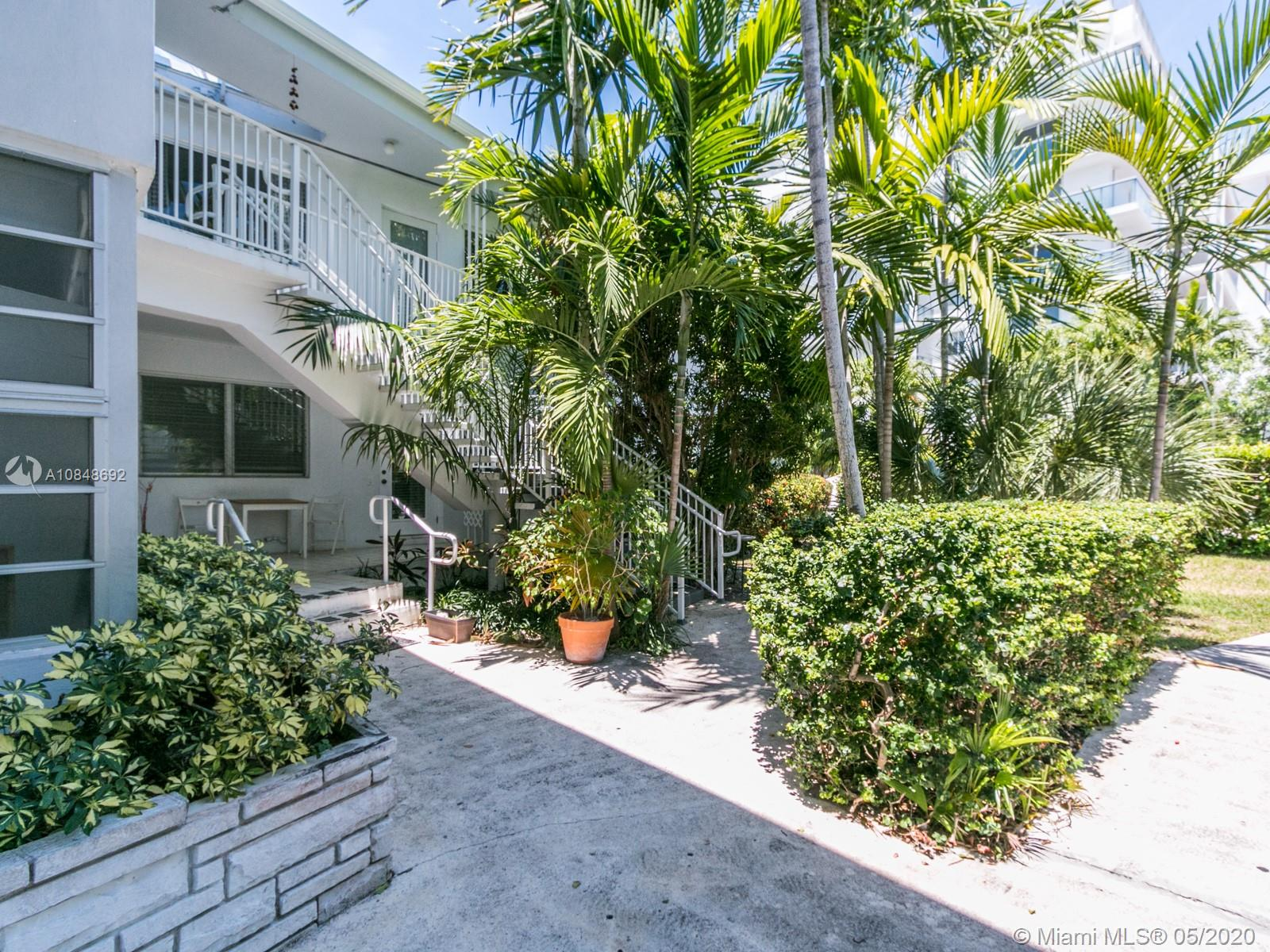 Like living in house.  Renovated and very spacious corner 3/2 in quiet neighborhood of Bay Harbor Islands. Fenced yard, Lap Pool, huge backyard and BBQ area right outside your door. Plenty of natural lighting and substantially remodeled with brand new kitchen and bathrooms, wood floors and new central A/C.  Renting ok first year of ownership.  Located in the heart of Bay Harbor Islands just around the corner from the beach, Bal Harbor Shops,  houses of worship, amazing restaurants and Located in an A rated school district! ***Easy to show and sell**.