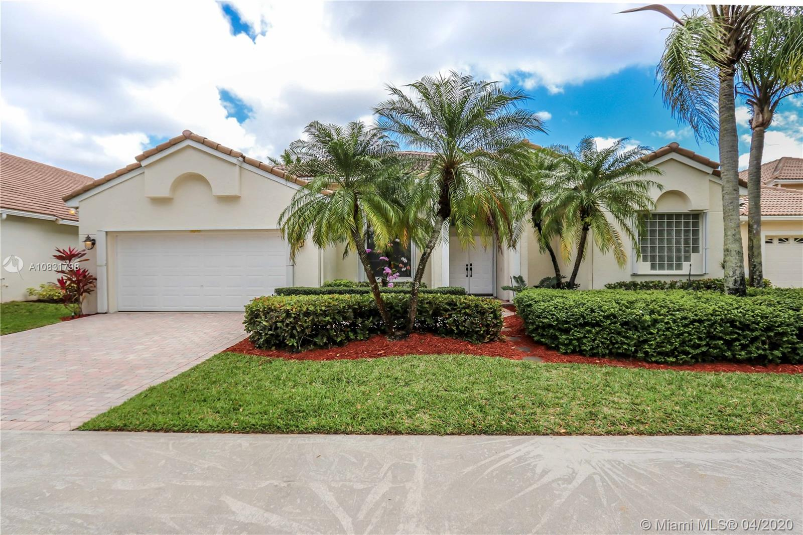"""This gorgeous one story home has 4 Bedroom ,3 bath and 2 car garage. In The Prestigious Community of Weston Hills Country Club. Very spacious interior floor plan. High ceiling, accordion hurricane shutters, and NEW ROOF (done 6 years ago). Without mention, stunning relaxing view of the lake. IDEAL LOCATION, close to community gate with easy access, and in a traffic less driveway. Near all highways, hospital and """"A"""" rated schools. . Very near, Weston town center, restaurants.  OWNER READY TO SELL. Weston Hills is a guard gated community. Resort style living within a Country club with golf course and Country Club membership is available."""