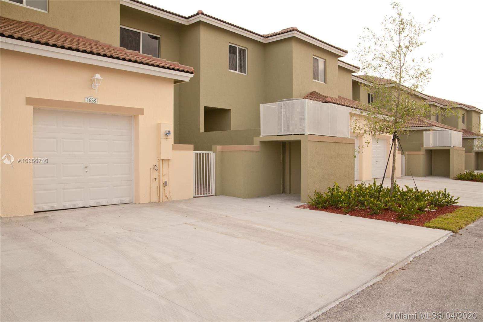 Beautiful 2 bedroom, 2.5 bath 2 story town home with 1 car garage and double driveway in Cali Greens at Keys Gate community.  Home features 18X18 tiled first floor, carpet upstairs, granite counters with tiled backsplash in kitchen and wood cabinets.  Upstairs has guest bedroom with en suite bath and master suite with huge closet and master bath.  Community includes pool, BBQ area, tennis courts, 24 hour roving security, AT&T cable and internet also included.  Must provide first month's rent and double security deposit.