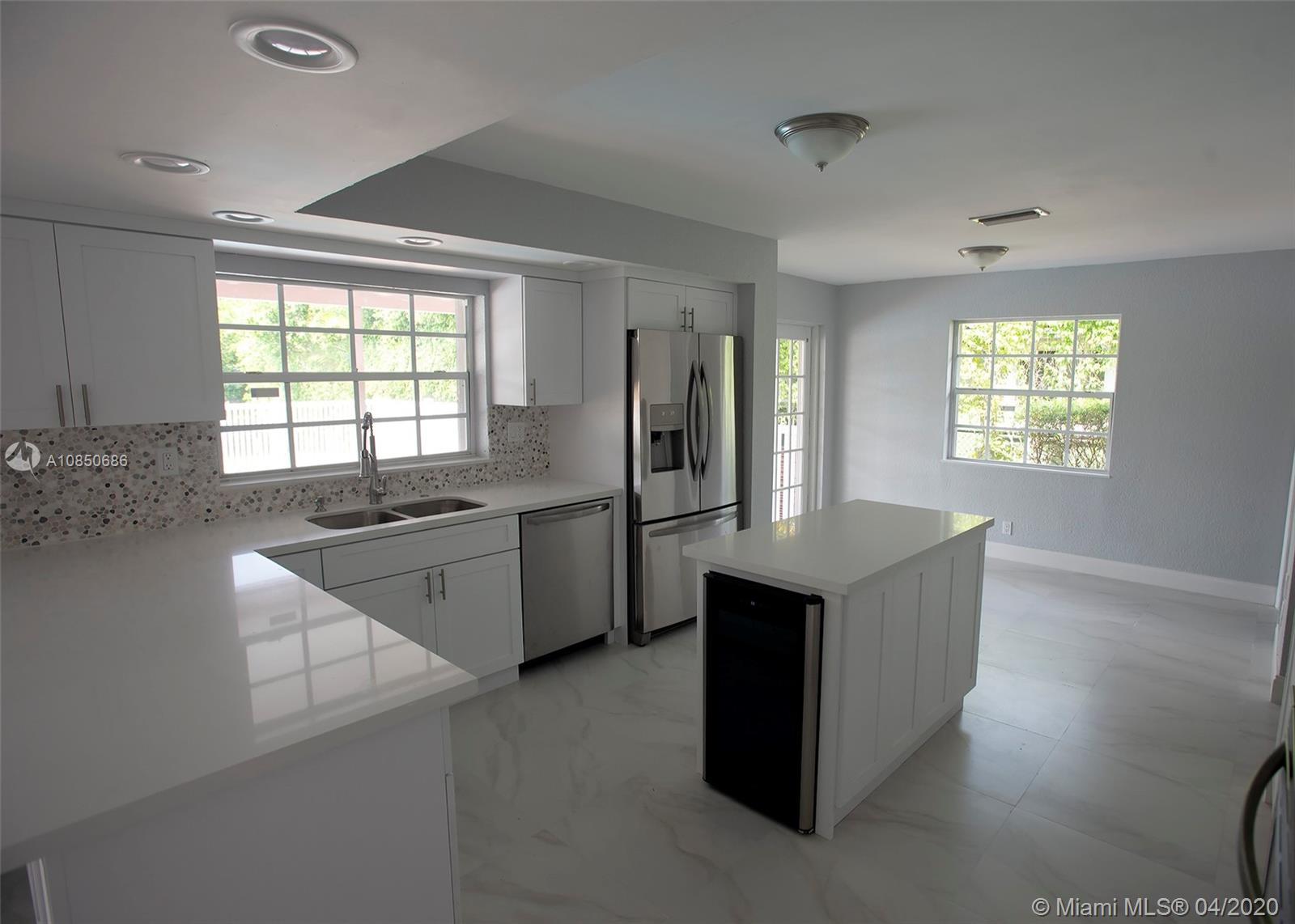 Welcome home! Come check out this recently renovated 4-bedroom/3-bathroom waterfront, pool home in the Cypress Run neighborhood of Coral Springs. Your family will enjoy pool views from the kitchen, family room, dining room, living room, and master bedroom. Property features new kitchen with stainless steel appliances and wine refrigerator, new floors throughout, vaulted ceilings, accordion shutters and a central vacuum system. Beautiful new pavers and landscaping add to the curb appeal. Other recent investments include fresh paint inside and out, remodeled bathrooms and new pool surface. AC replaced in 2014, New roof. 2 Master Bedrooms. No HOA! Won't last!