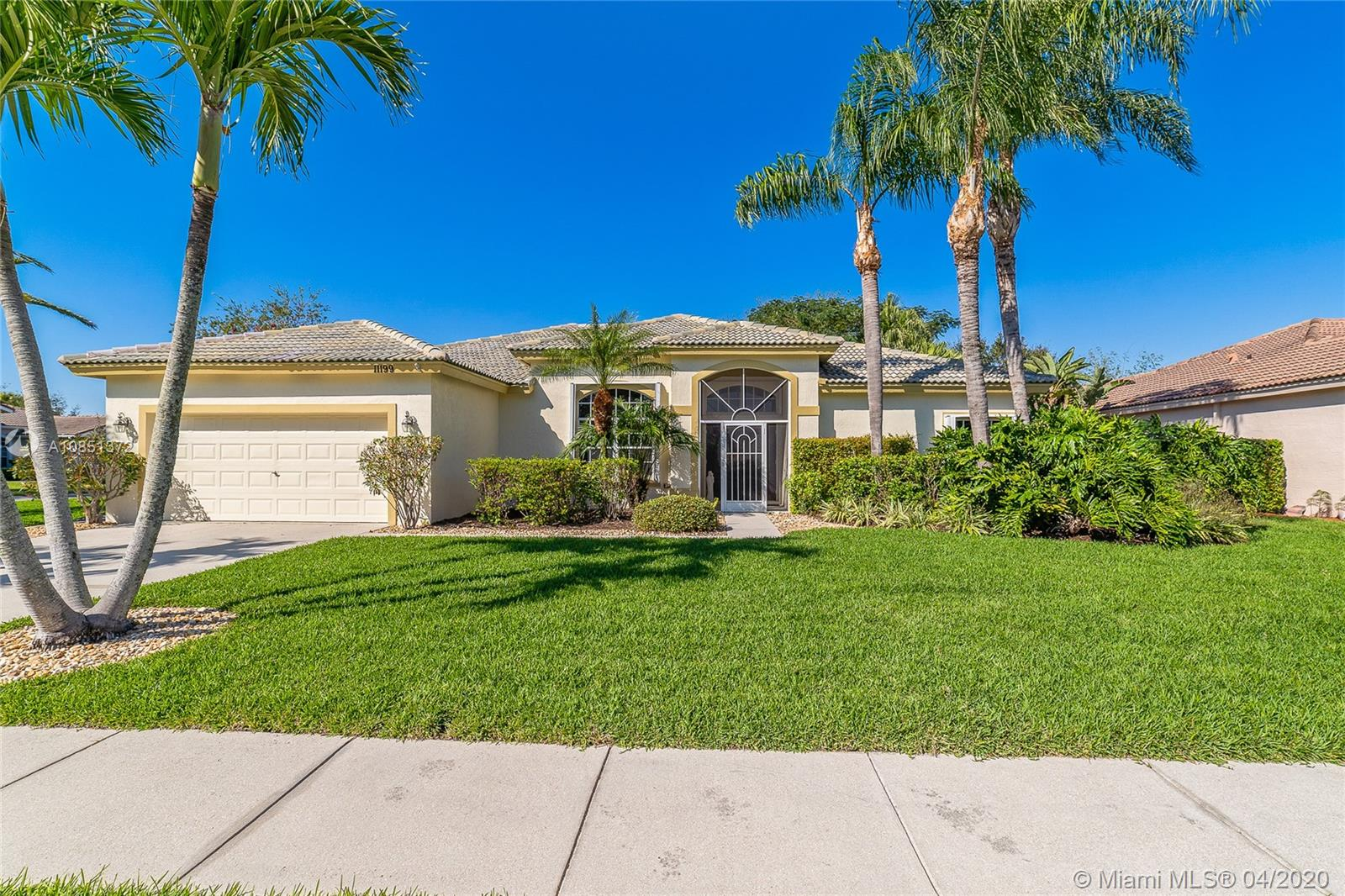 "Impeccably cared for, this lusciously landscaped 4 bedroom home located in the highly desirable Grand Isles in Wellington boast 42"" kitchen cabinetry, newer refrigerator, eat in kitchen, volume ceilings, split floor plan, with very spacious rooms. Tastefully painted in soft colors, beautiful lighting fixtures and window treatments. Exterior features a massive corner lot, huge screened in covered patio, fire pit, beautifully landscaped, and very private, the yard has been recently re-sodded. Guard gated community with all the amenities, low hoa fee, great pubic schools from k-12 and very close proximity to the equestrian grounds."