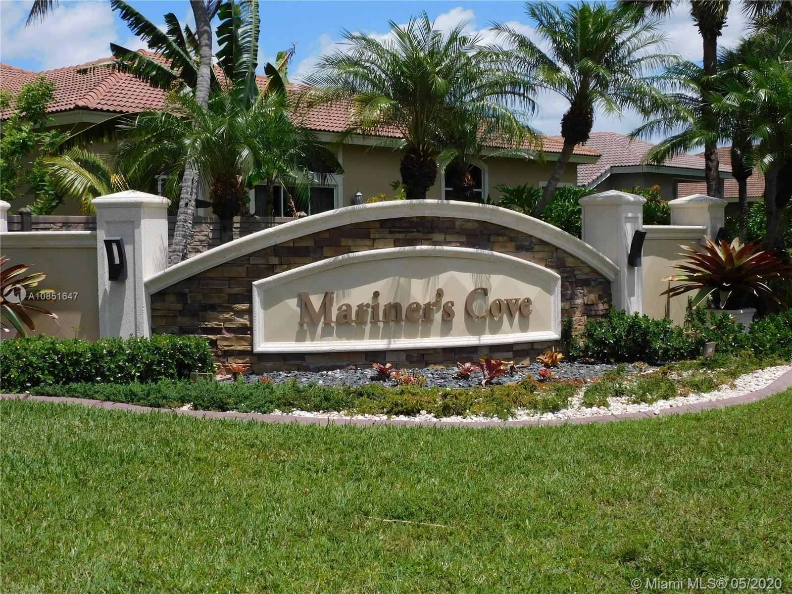 Welcome to Man Gated 24/7 Mariners Cove, canal home where a dock and boat are permitted and feeds into Lake Coral Springs. Main house is a 5 bedroom+ loft with 2 seperate spaces- can be office/den/playroom/gym. There is an additional 1/1 Guest House right off the Courtyard Pool with private entrance. Upgraded newer kitchen with wood,Omega  Cabinets, granite counter tops, SS appliances. High ceiling, crown moldings and Teak wood floors in all social areas add elegance to this unique home. 3 car garage and driveway that can accomodate up to 6 more cars. Great home to entertain.