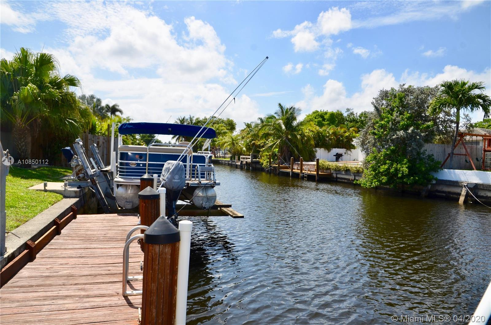 New on the market, a boaters dream house in Fort Lauderdale's Waterways! This 4 bedroom, 2 bathrooms has 75' waterfront on a deep water canal with a full service 29' dock, a boatlift and a pool. The open floor plan with 1,800sf will let you see the pool and the waterways from your living and your dining room. Open the new impact doors from your living area to relax in your screened extra large Florida room at his best (another 485sf). The Florida beach lifestyle! Tile floor throughout, new windows & doors, stainless steal appliances, master bathroom remodeled, and more exterior features like the carport, shed and utility room. Take your boat and go to the ocean, 3 fixed bridges. Dont wait, priced to sell fast!