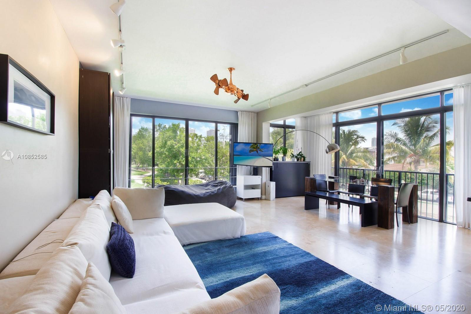 This Venetian townhome offers spectacular panoramic views, with 2,400 SF living space and a 1,200 SF roof-top terrace with views of downtown Miami, the Atlantic Ocean, and Biscayne Bay. The main floor living area includes floor to ceiling windows overlooking the park and the water. The second floor features the kitchen, dining, family room and a bedroom and bath.  Upstairs on the 3rd floor is the master bedroom, den and master bath.  The Venetian amenities include 24 hour concierge, covered parking, 2 swimming pools, fitness center, sauna, BBQ area, clubhouse and 2 lighted tennis courts.