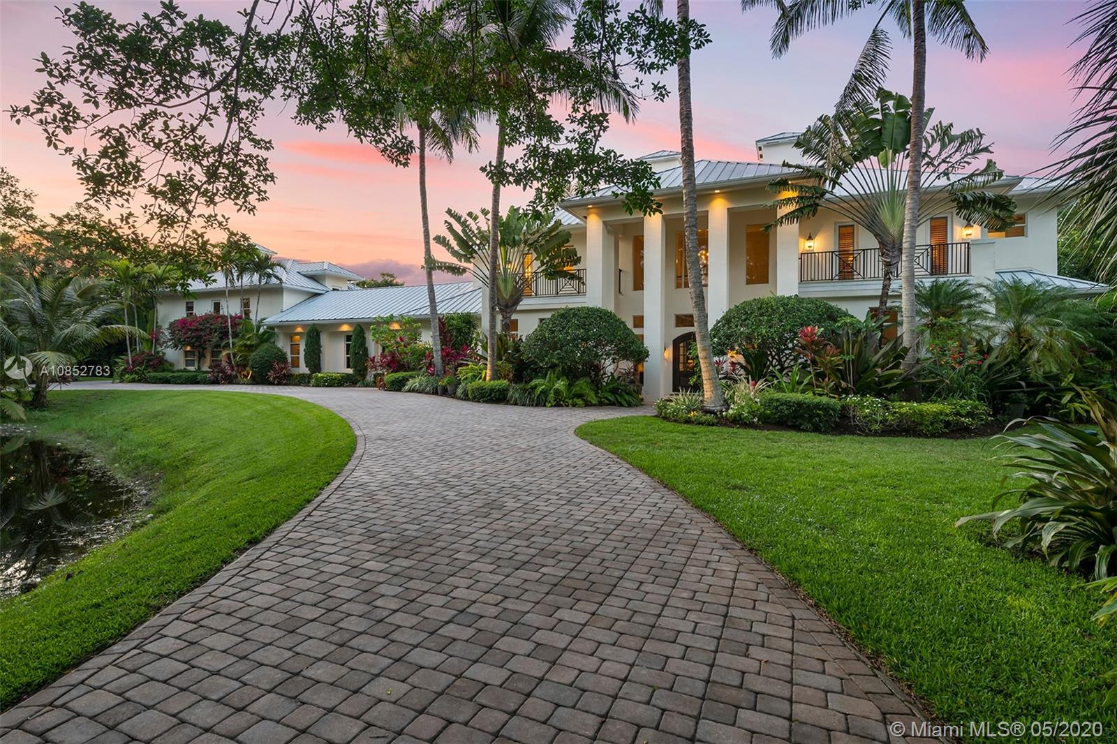 Welcome to 8899 NW 70th Court,  nestled into one of the most prestigious neighborhoods of Parkland, Florida - BBB Ranches. This 3+ acre estate is situated on luscious gated grounds and is the true meaning of luxurious equestrian living. The coastal inspired design features 7 bedrooms, 7 bathrooms, and 2 half bathrooms. The chef's style kitchen is equipped with thermador appliances. Perfect for entertaining, the property features a theater room, game room, a covered lanai, a resort style pool,  summer kitchen, and an abundance of outdoor living spaces surrounded by your own tropical oasis! Just when you think this property can't get any more impressive, there's also an eight stall barn! Located 10 minutes from Boca Raton, 30 minutes from Fort Lauderdale and less than an hour from Miami.