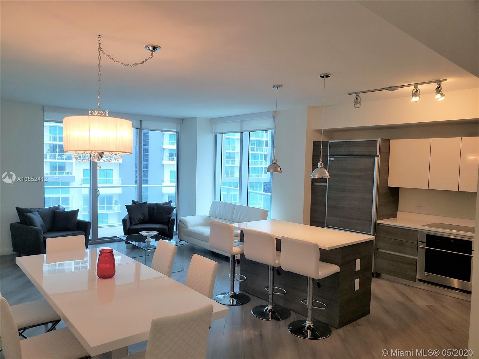 BRING YOUR OFFERS WITH YOUR TOOTHBRUSH TO THIS Tastefully furnished unit in the most desirable line in the building (01 line, corner unit). Large balcony with great skyline views! Furniture from Modani, Sony smart TVs, Quartz kitchen counter tops throughout, porcelain wood look tiles, GE Monogram appliances, customblack out shades, built out closets, 1 assigned self parking space near elevator 24 hour doorman, security water high speed internet and cable included Washer and dryer inside unit. Luxury building w great amenities; theater w state of the art audio/visual equipment, private cabanas, sauna, roof top pool, fitness center, kids room, lounge room. Centrally located steps from the Metro Mover. Within walking distance to fine restaurants, Brickell City Center& 8.5 miles from MIA