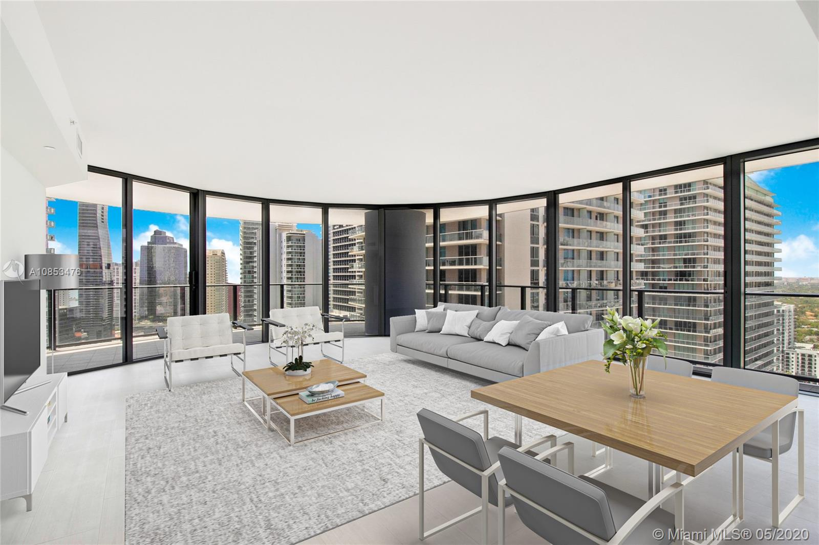 Situated in the heart of downtown Brickell, luxury living and superb location define this 3 BR, 3.5 BA residence. Positioned in best 02 line, this corner apt showcases the largest floor plan of the tower residences @2,025 SF, and huge wrap-around balcony delivers lavish sunset & city views. Interior features floor-to-ceiling windows, Italian marble, Snaidero kitchen & Miele appliances. Premium perks include rooftop Sky Club on 64th floor, which integrates a pool w/ 360° unobstructed water & skyline views, a spa & fitness center. Flatiron Club @ 17th & 18th floors offers movie theater, lap pool, kid's playroom, lounge & billiards room. Full-time doorman, concierge & 24-hr valet. Super location brims w/ steps-away shopping, dining & Brickell City Centre. 3 parking spaces & private storage.