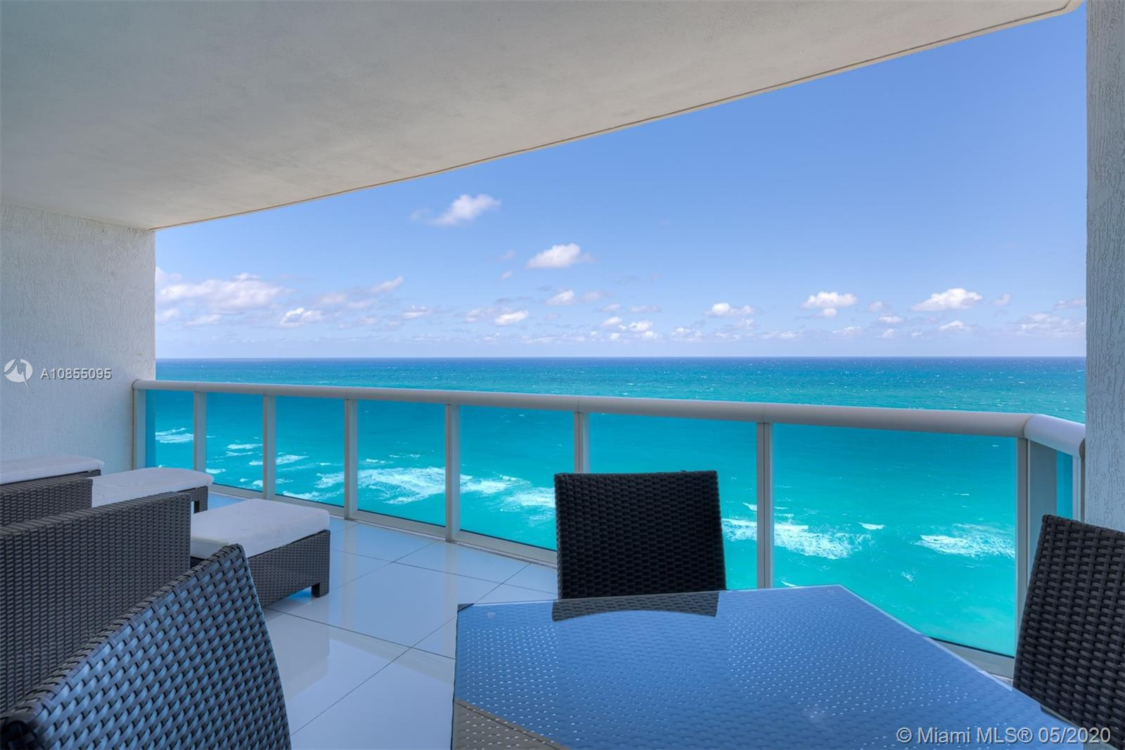 Impeccable fully furnished residence with direct ocean views. Wonderful flow-through floorplan with 3 bed, 3 1/2 ba + private elevator lobby, and family room. Gorgeous views to the east and to the west. Full-service luxury condominium with all luxury amenities.