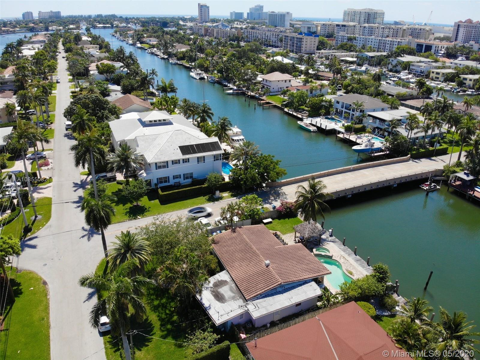"""BOATERS AND YACHT OWNERS TAKE NOTICE!! EXCELLENT OPPORTUNITY TO BUY THIS WATERFRONT RESIDENCE IN THE HEART OF LAUDERDALE HARBORS ON 80"""" OF DEEP-WATER AND EITHER REMODEL OR CONSTRUCT A NEW HOME. EXTREMELY CLOSE OCEAN ACCESS AND LOCATED ON A WIDE CANAL CAN ACCOMMODATE A CATAMARAN OR SEVERAL BOATS STERN TO DOCK FOR YOUR BAHAMIAN GETAWAY. ONLY ONE CANAL AWAY FROM THE ENTRY TO PORT EVERGLADES AND OCEAN. ENJOY THE SOUTHERN EXPOSURE POOL & SPA. ROOF NEW IN 2006, HEAT REFLECTIVE TILES AND INSULATED. UPDATED INTERIOR 2 MASTER SUITES. OPEN FLOOR PLAN. WALK TO LOCAL PUBS, SHOPS AND FINE DINING. THE EXISTING 2 BEDROOM/ 3 BATHS 1917 SQ. CORNER POOL HOME ON SITE COULD FEASIBLY BE RENOVATED!! EASY TO SHOW."""