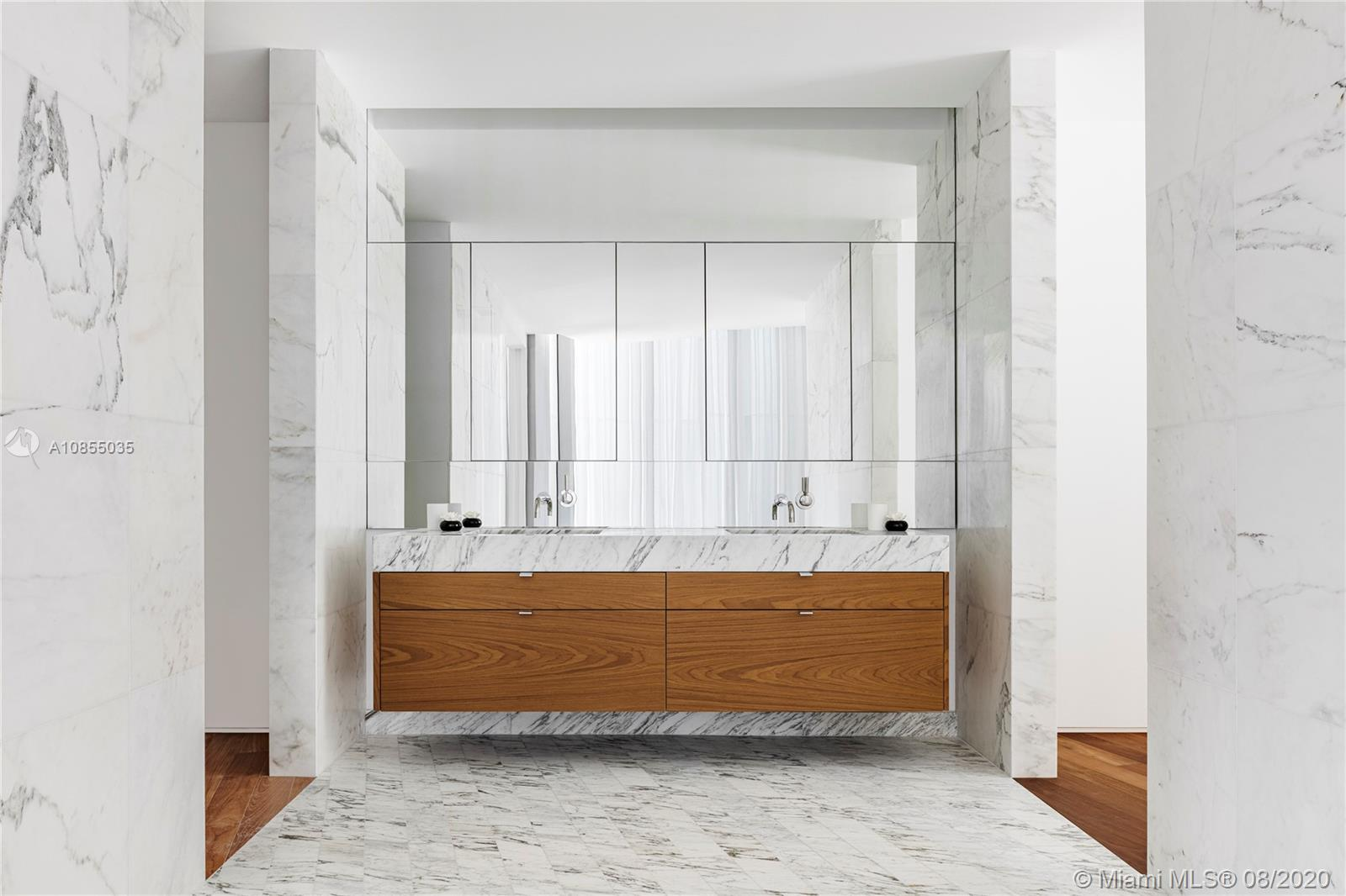 *Composed of 59 individually designed waterfront residences around a glittering lagoon, Monad Terrace by Pritzker Winner, Jean Nouvel, provides brilliant light, private outdoor space, climbing gardens, unique sawtooth honeycomb facades & stunning sunset views of Biscayne Bay. Kitchens with dramatic sculptural cantilevered marble island in Calacatta. Master baths with richly veined, spacious stone countertops, marquetry flooring and tiled walls. Other notable features include custom cabinetry & built-in features, designer fixtures, teak flooring throughout & private elevators. Estimated delivery in 2020. Images are from Model Residence or Artist Rendering.