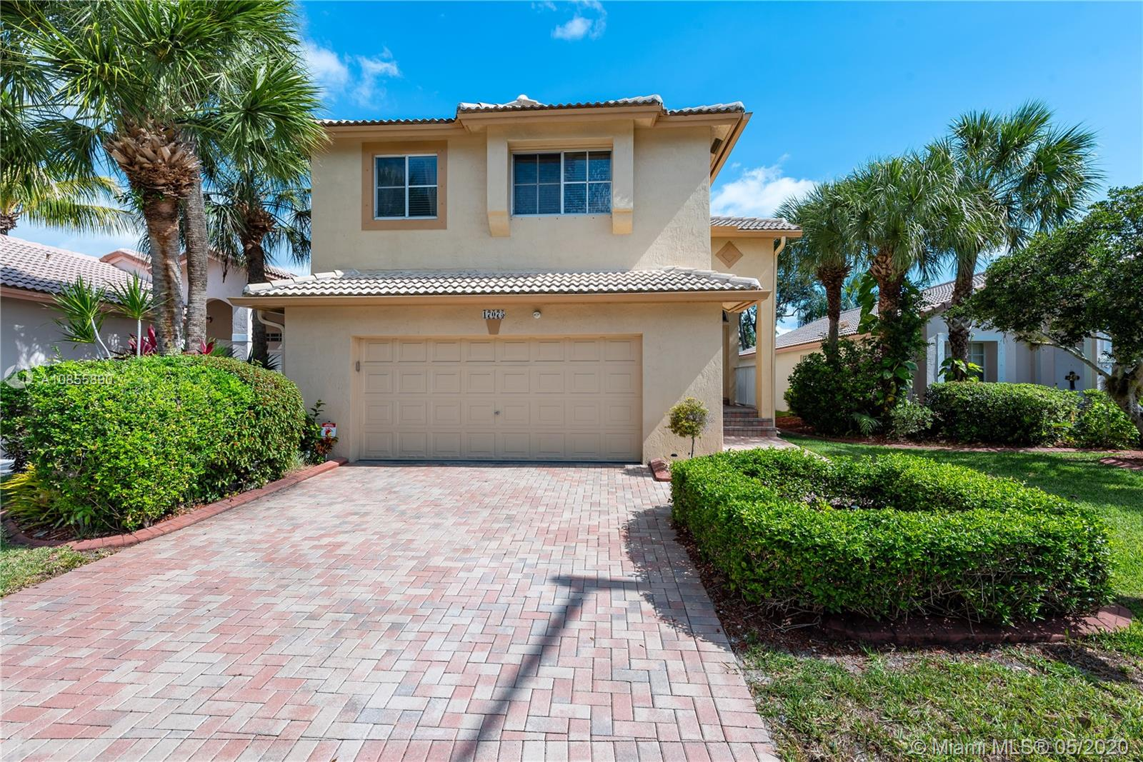 "Highly Desirable 3 Bedroom, 2.5 Bath, BOUGAINVILLAEA MODEL HOME in the Sought After RESERVE at PEMBROKE ISLES. Featuring: Large Open Eat-in Kitchen with Serving Bar and Pantry, Spacious 2nd FL Master Suite, Large Walk-in Closet, Dual Sink Vanity, Roman Soaking Tub, Neutral Flooring, Vaulted Ceilings, Open Patio, Fenced Lot and Tropical Landscaping. The Perfect Family Home…. Residents of Pembroke Isles Enjoy: Fitness Center, Aerobics, Sauna, Tennis, Racquetball, Basketball, Soccer, Beach Volleyball, Swimming Pools, Jacuzzis, Fishing Piers, Walking/Biking Trails, Covered Picnic Areas, Children's Playground & Tot Lot.  HOA Includes: Security, Landscaping, Cable, Internet & Alarm Monitoring.  Convenient to Shopping, Dining, Travel and ""A"" Rated Schools. Hurry Call Us Today!"