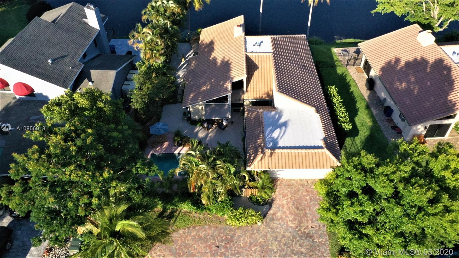 Rare Waterfront Opportunity - 3 Bed - 3.5 Bath - 2417sq/ft - Pool (auto chlorinated) - Waterfront w/ Golf Course View - Brand New Roof - 2 Car Garage - Wood & Tile Throughout - Spacious Master Suite - Wood Burning Fireplace - Large Circular Driveway - 2016 AC - New Wooden Deck - Tropical Landscape - MUST SEE!!