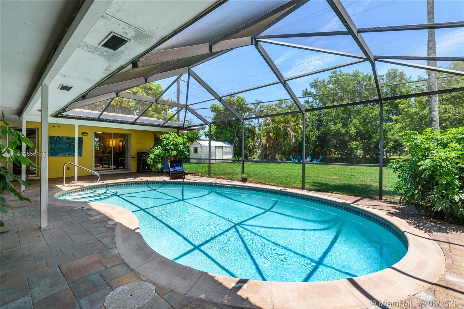 Do not miss this EXCELLENT OPPORTUNITY to own a charming 3/BR,2/BA, pool home in DESIRABLE Plantation. On appr. 13,000 square feet, this property boasts a screened-in covered paved patio & pool overlooking a spacious backyard w/lush lawn to a canal. Features a bright kitchen w/stone countertops & sliders leading out to the patio. VAULTED CEILING w/WOOD BEAMS in LR, light wood laminate flooring, & sliders w/views of pool & yard. Terrazzo flooring & SPLIT BEDROOM FLOORPLAN w/master suite & cabana bathroom. Access the patio from any room in the house. Long driveway & 2-car carport. There is AMPLE STORAGE including a utility/Laundry/storage room, plus storage room off the back of the house & an OVERSIZED SHED in the yard. Near schools, restaurants, highways, & more. NO HOA. Bring all offers.