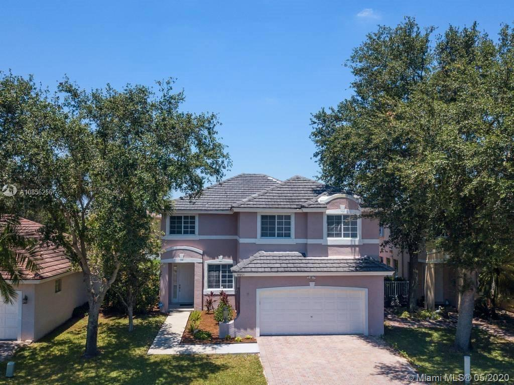 Normandy of Pembroke Lakes Beauty!  Largest model in community with over 2,500sqft. Home features 2 large masters, new laminate floors upstairs. Low association dues include: basic cable, gated entrance, community pool and community maintained sprinklers.  Enjoy the relaxing water views from your backyard. Virtual matterport tour is available.